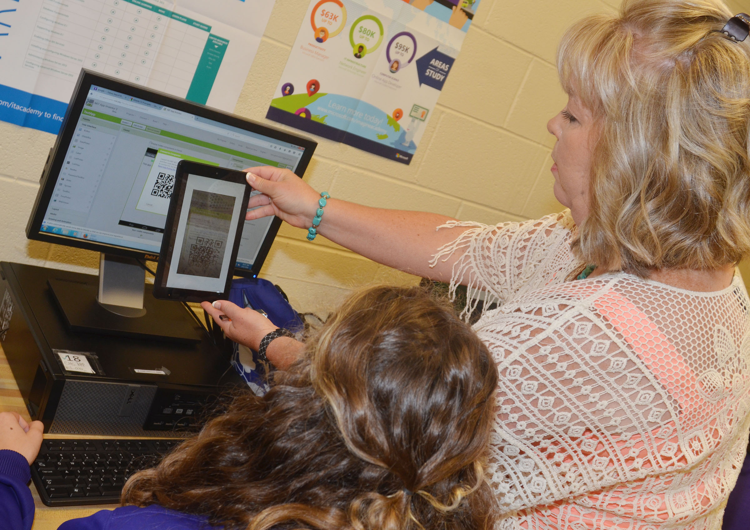 Sonya Kessler helps a student in her CHS computer science principles class, which was a new class nationwide in the 2016-2017 school year.