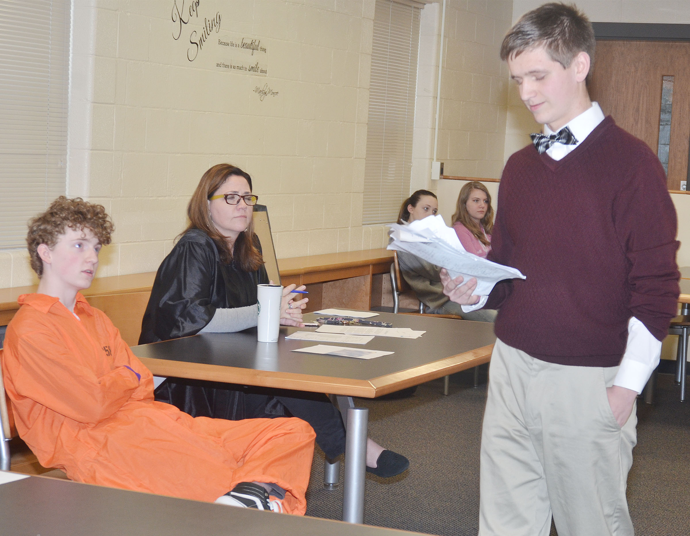 CHS sophomore Myles Murrell, portraying a prosecuting attorney, questions sophomore Jackson Hinton, who was on trial for murder, as judge Susan Dabney listens.