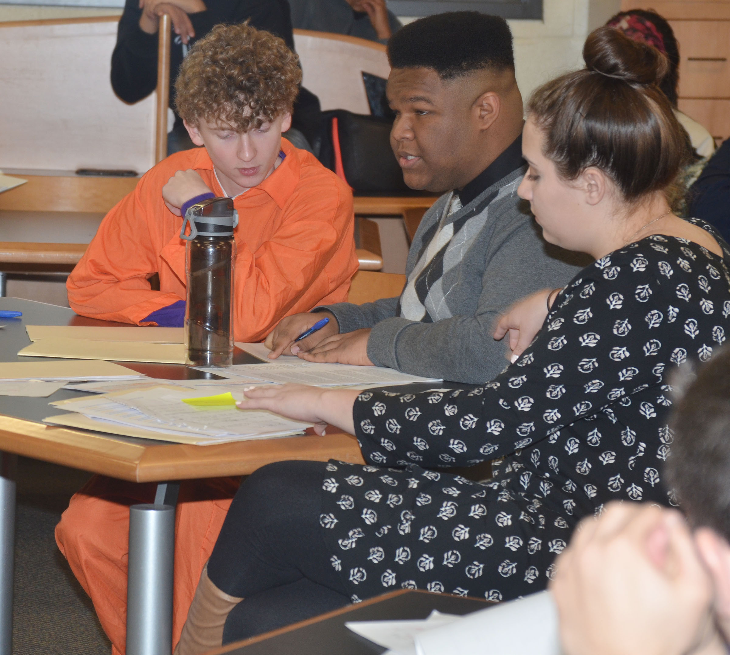 CHS sophomore Jackson Hinton, at left, listens as his attorneys Jeremiah Jackson and Elizabeth Sullivan, sophomores, question a witness.