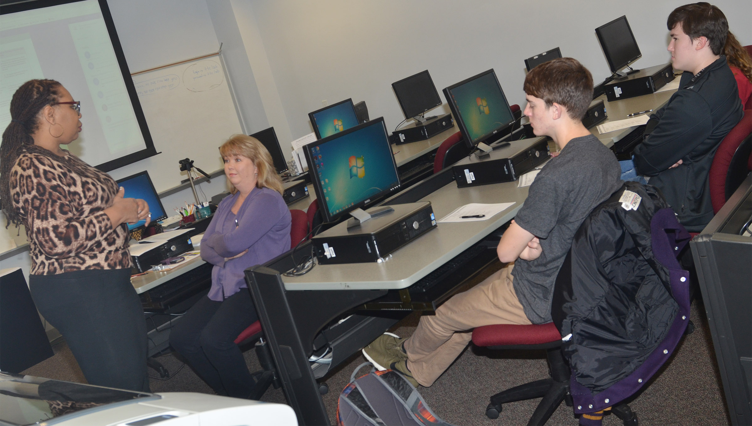 Monique Morton, director of math and computer science at Advance Kentucky, recently came to Campbellsville to lead Sonya Kessler's AP computer science students in a study session. Sonya Kessler is at left and CHS seniors Murphy Lamb and Zack Settle are at right.