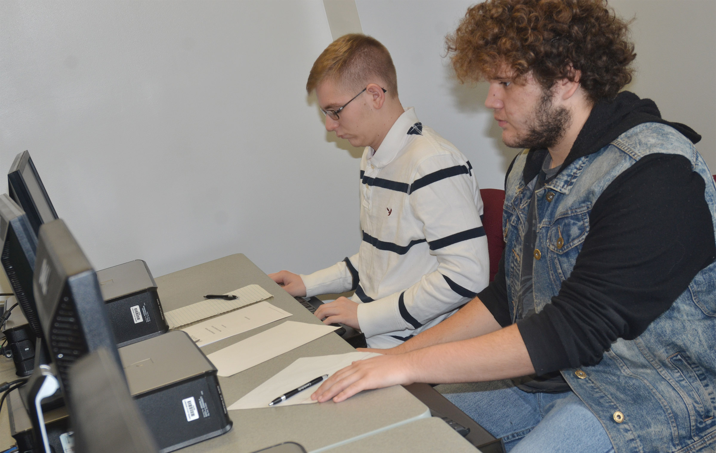 CHS sophomore Brandon Greer, at left, and senior Dalton Ballentine do research to answer a mock AP exam question.