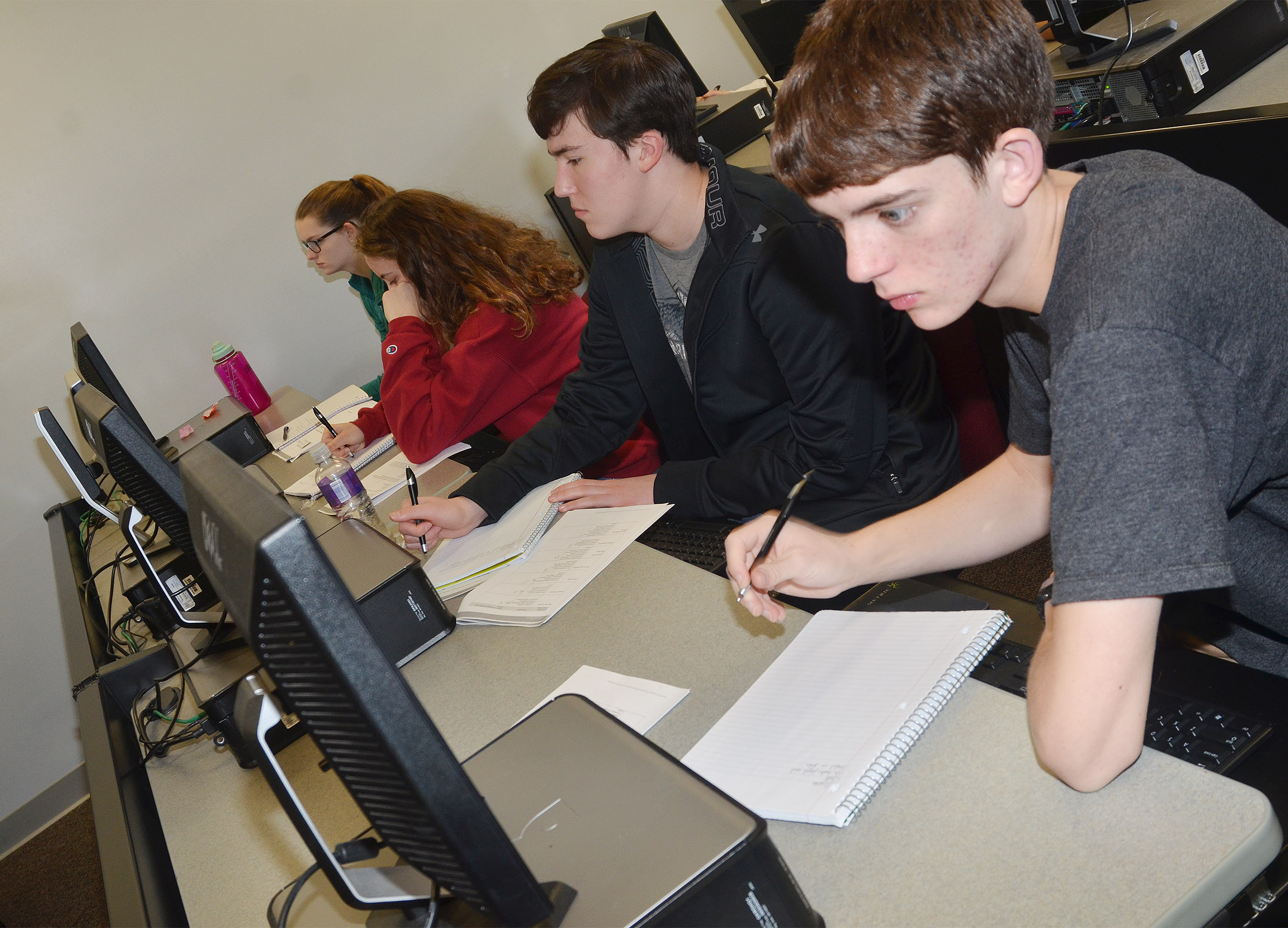 From left, CHS seniors Blair Lamb, Caroline McMahan, Zack Settle and Murphy Lamb do research to answer a mock AP exam question.