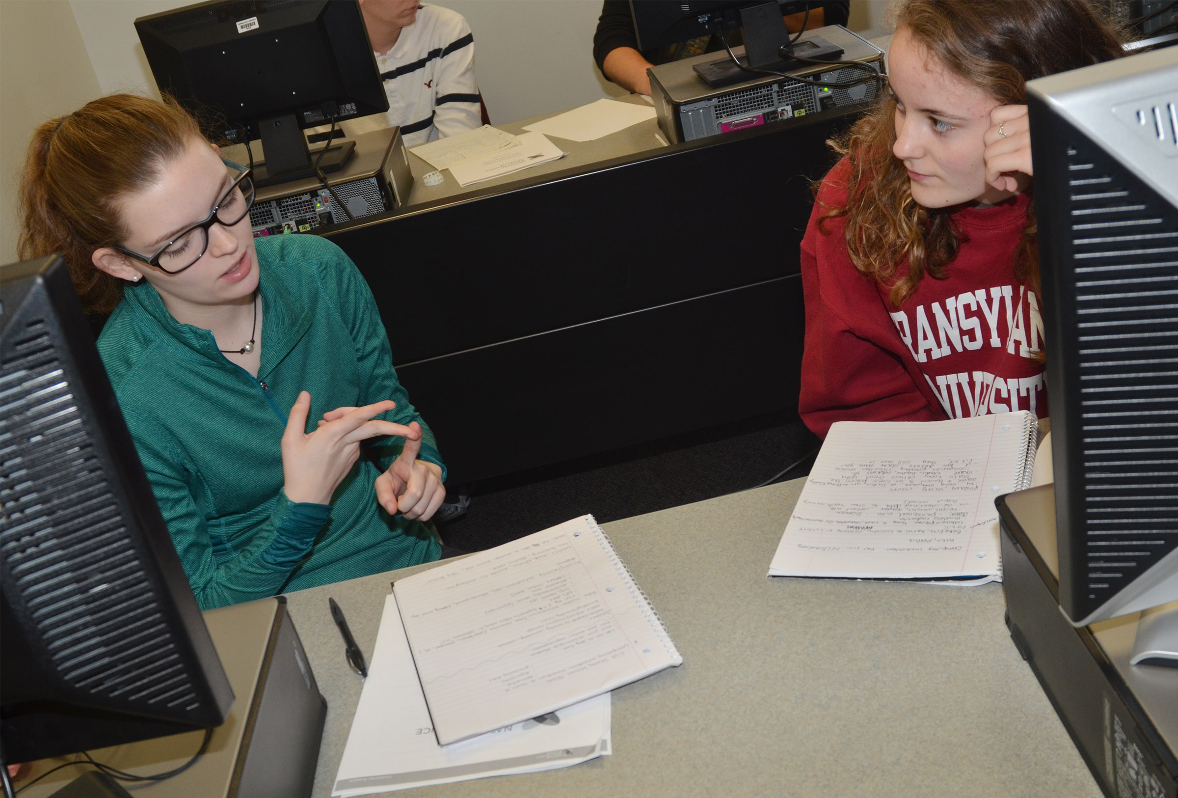 CHS seniors Blair Lamb, at left, and Caroline McMahan discuss the answer to a mock AP exam question.