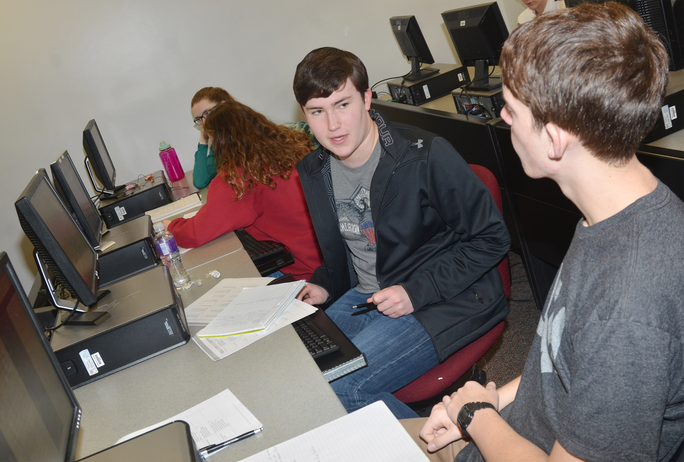 CHS seniors Zack Settle, at left, and Murphy Lamb discuss the answer to a mock AP exam question.