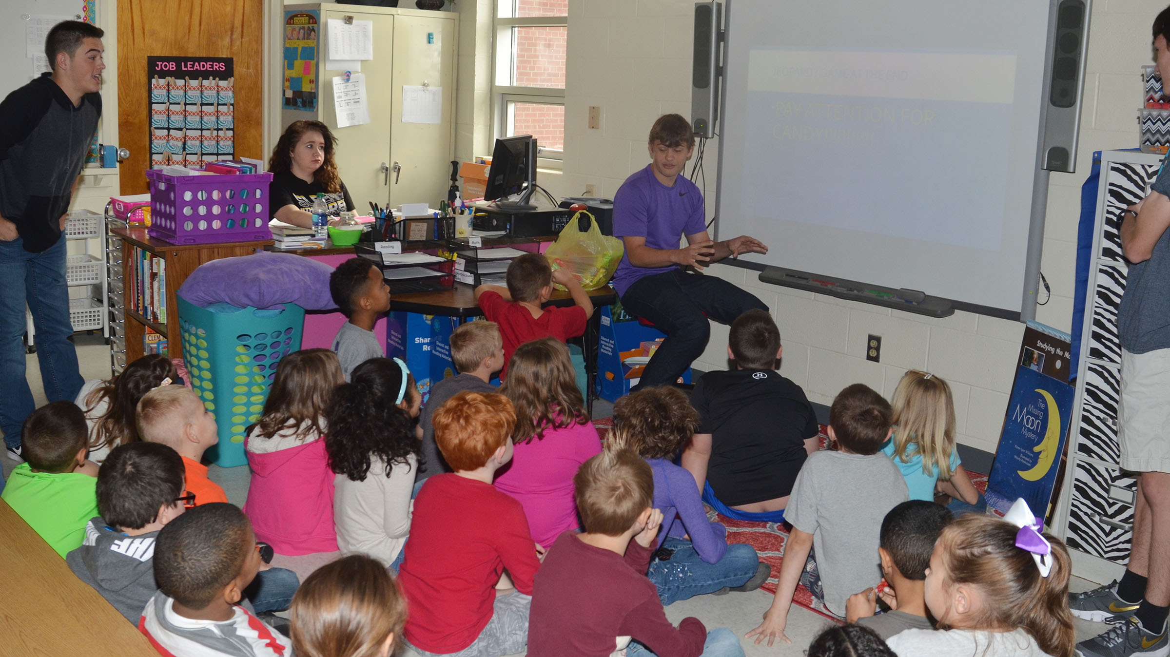 CHS sophomores, from left, Ryan Kearney, Leslie McKenzie, Treyce Mattingly and Ian McAninch talk to CES second-graders about government.