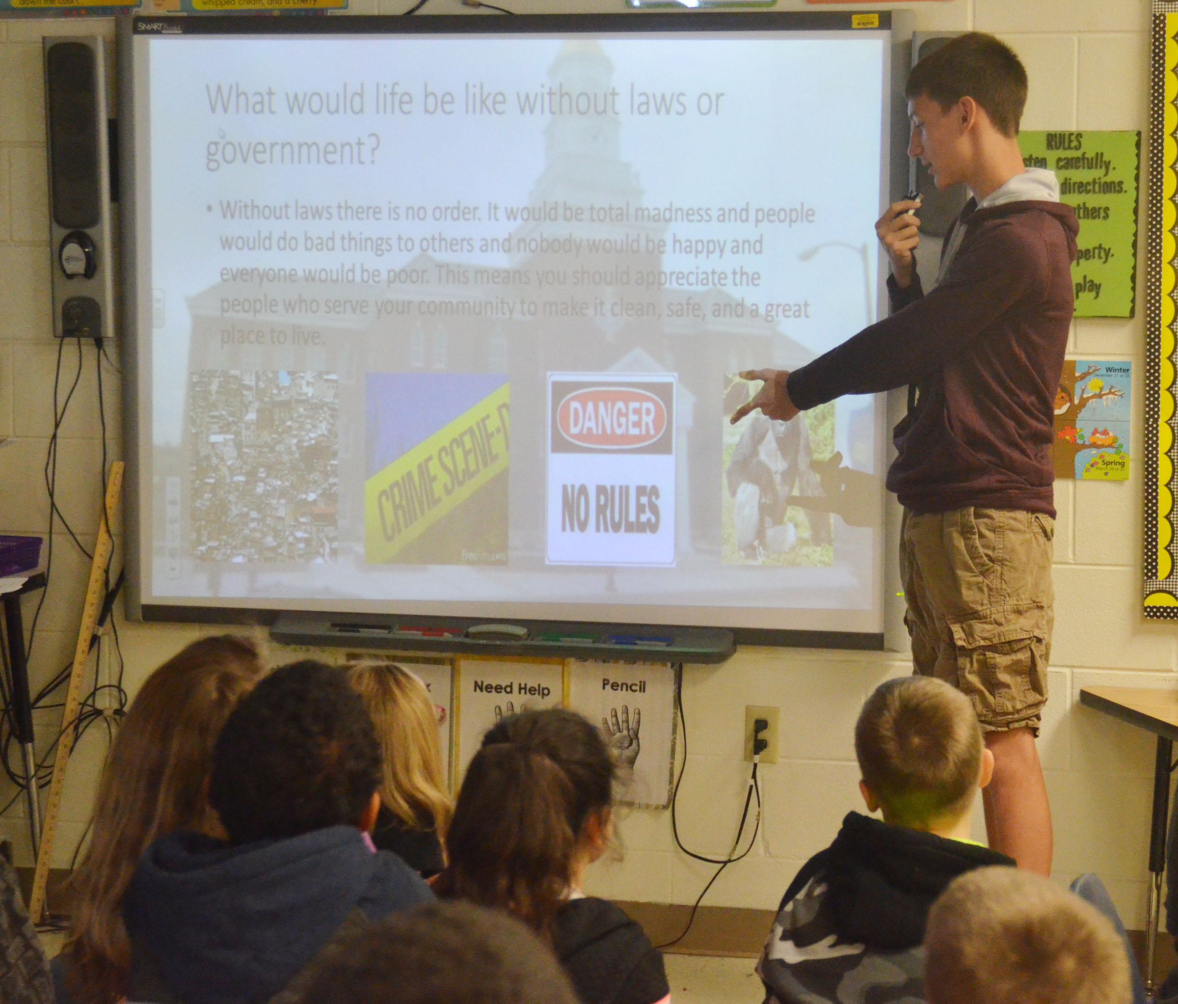 CHS sophomore Evan McAninch talks to CES third-graders about what life would be like without any laws.