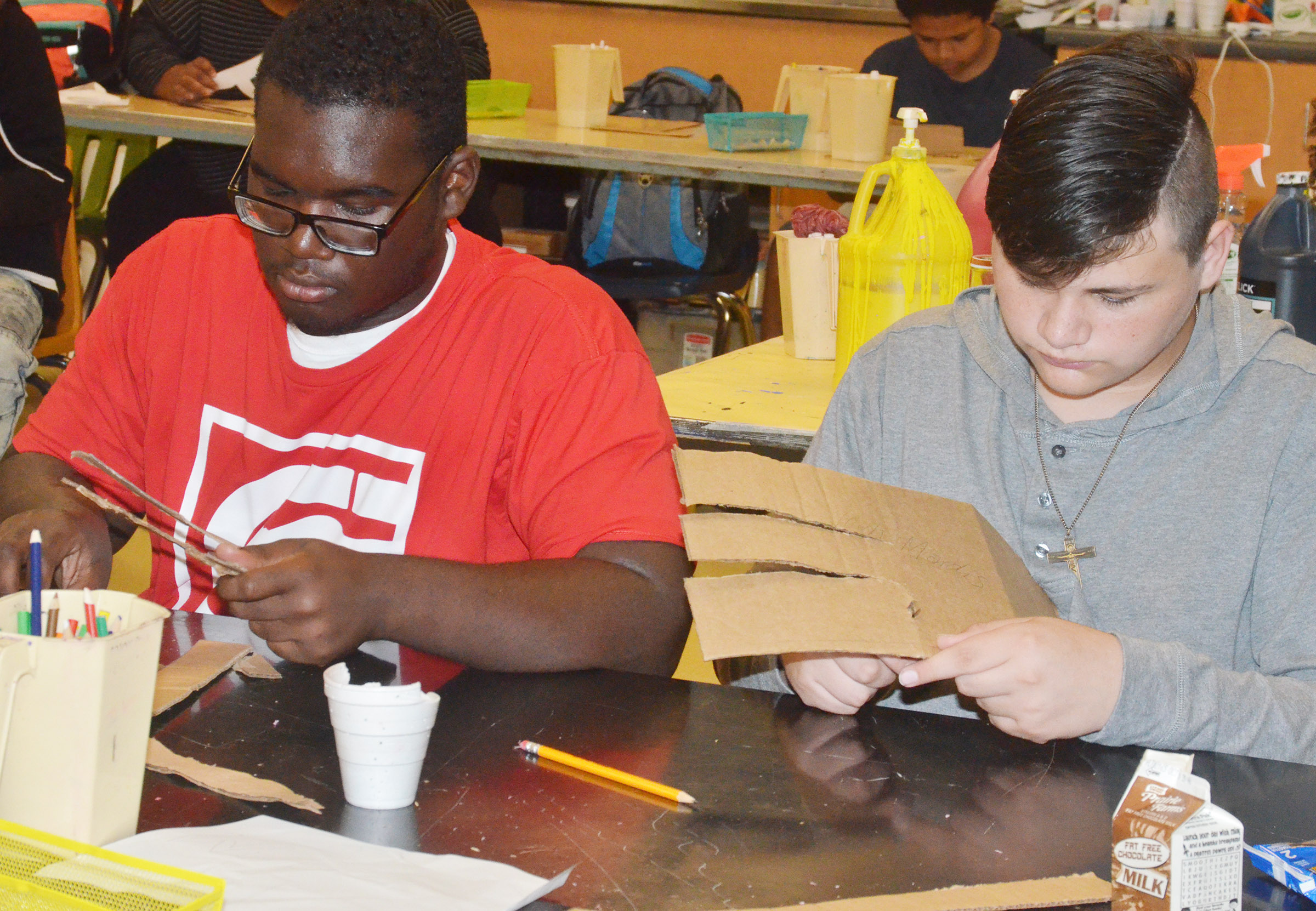CHS sophomores Taekwon McCoy, at left, and Gabriel Gutierrez cut out their letters.