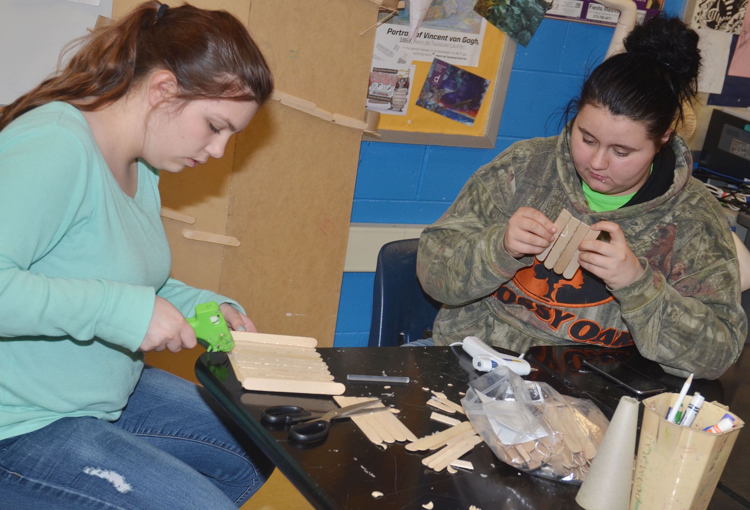 CHS freshman Shelby Hunt, at left, and sophomore Amanda Dotson work together to build their ball dropper.
