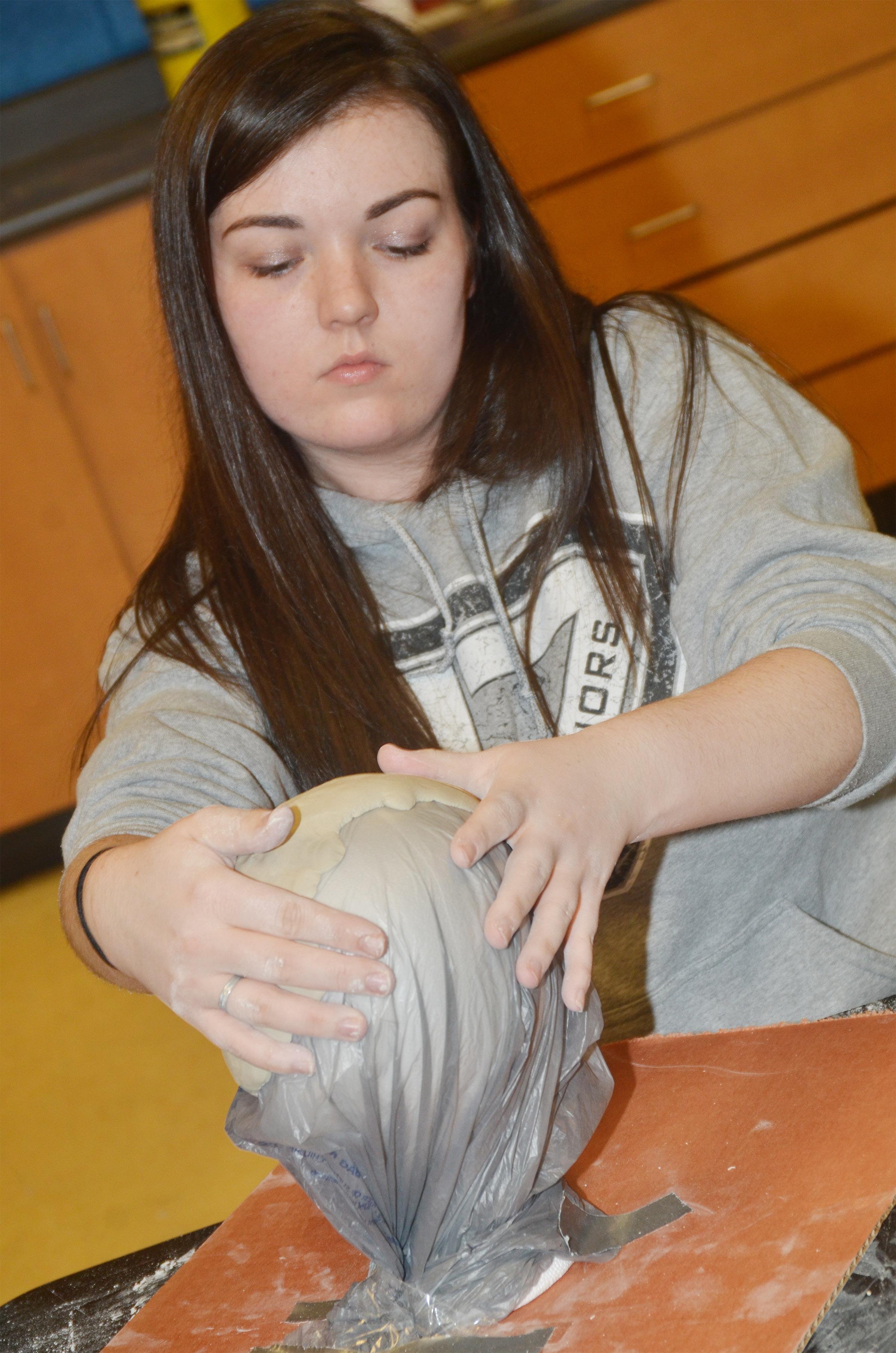 CHS senior Tiffany Stagner uses a foam head to shape her clay.