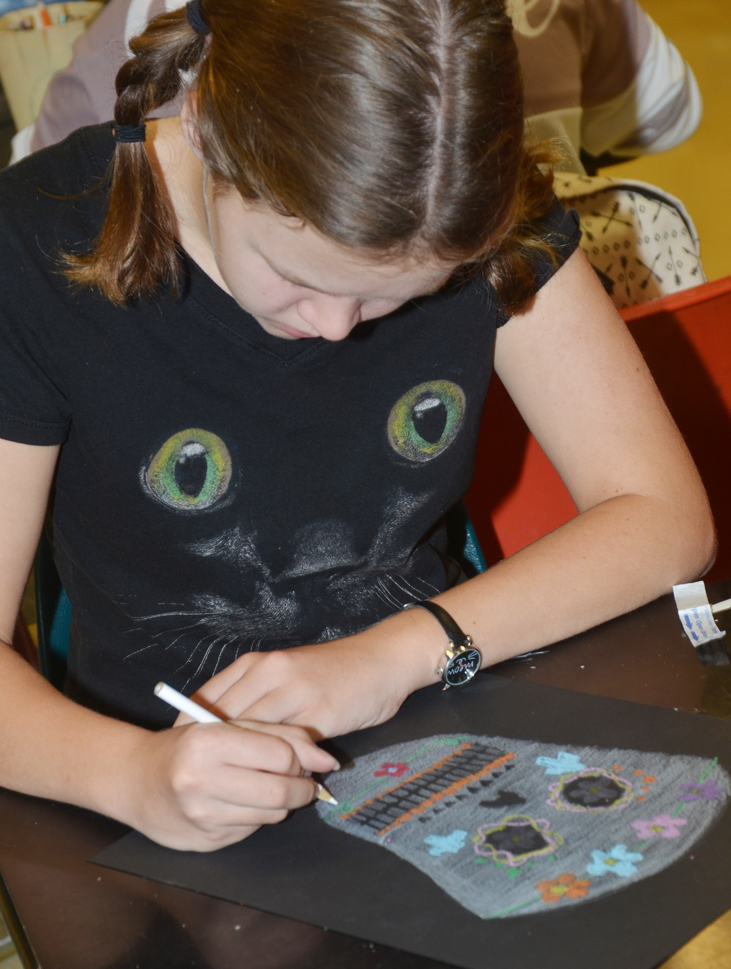 Campbellsville Middle School seventh-grader MaCayla Falls colors her Day of the Dead skull.