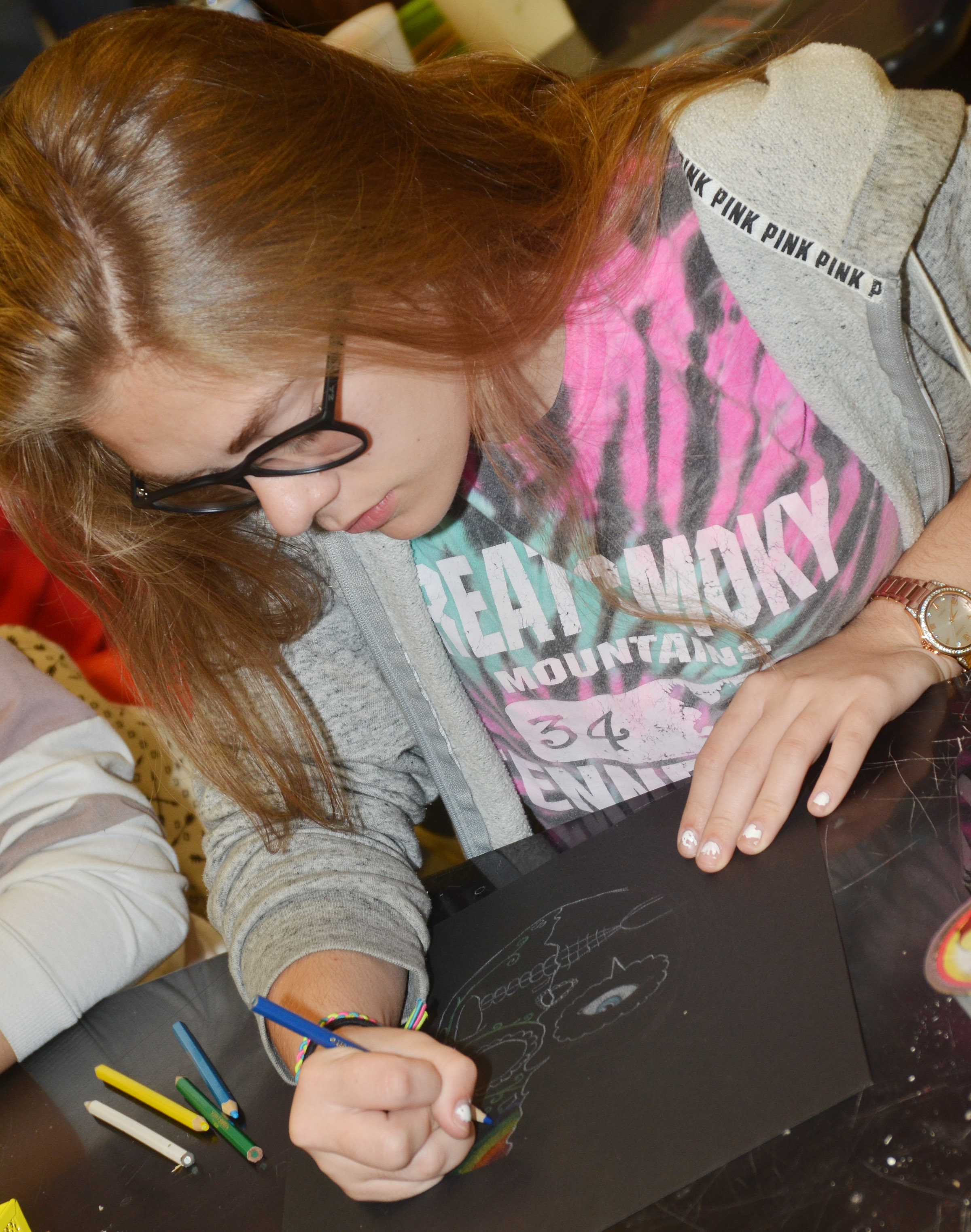 CHS freshman Emily Kerns colors her Day of the Dead skulls.