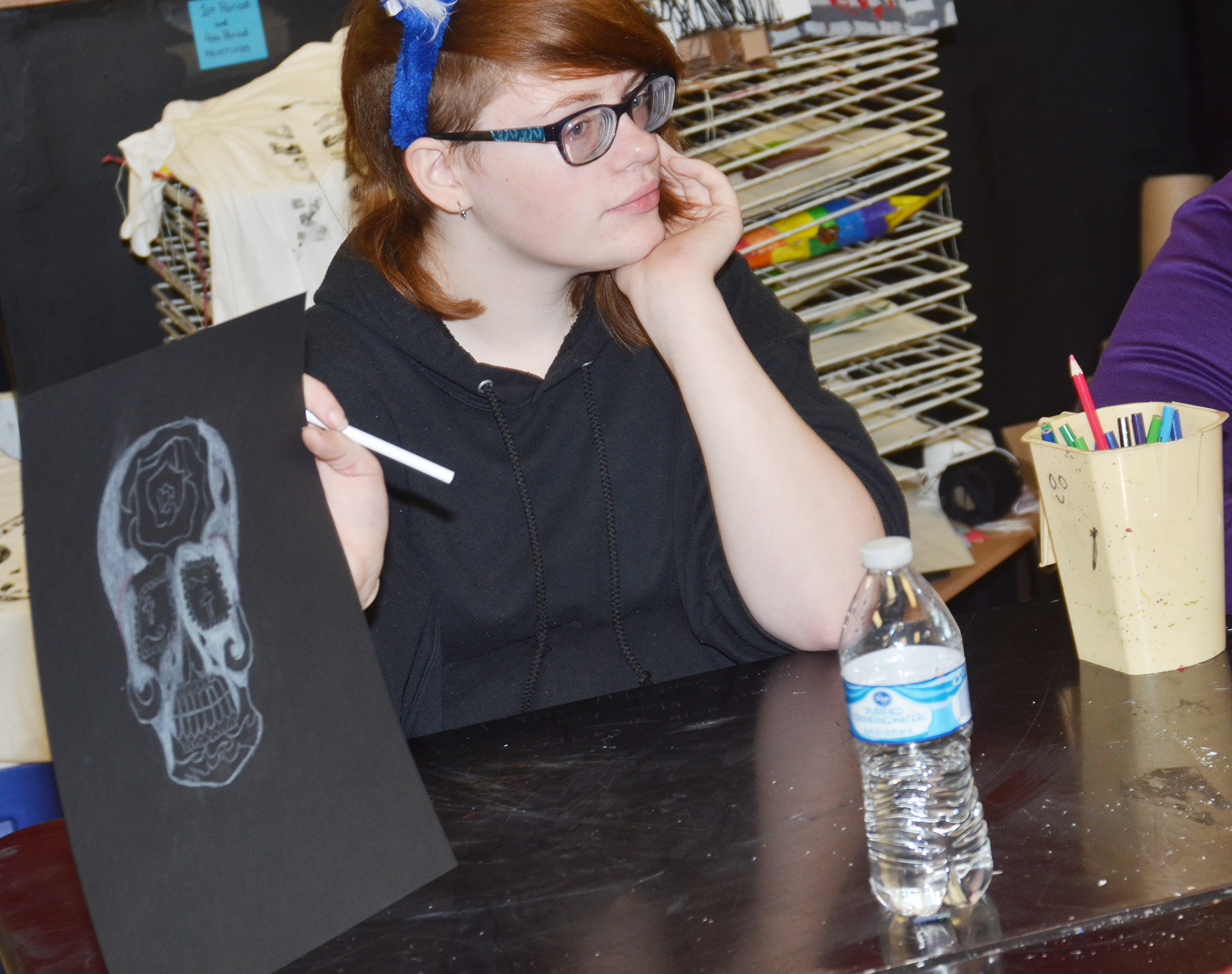 CHS freshman Sierra Releford shows her classmate her Day of the Dead skull.