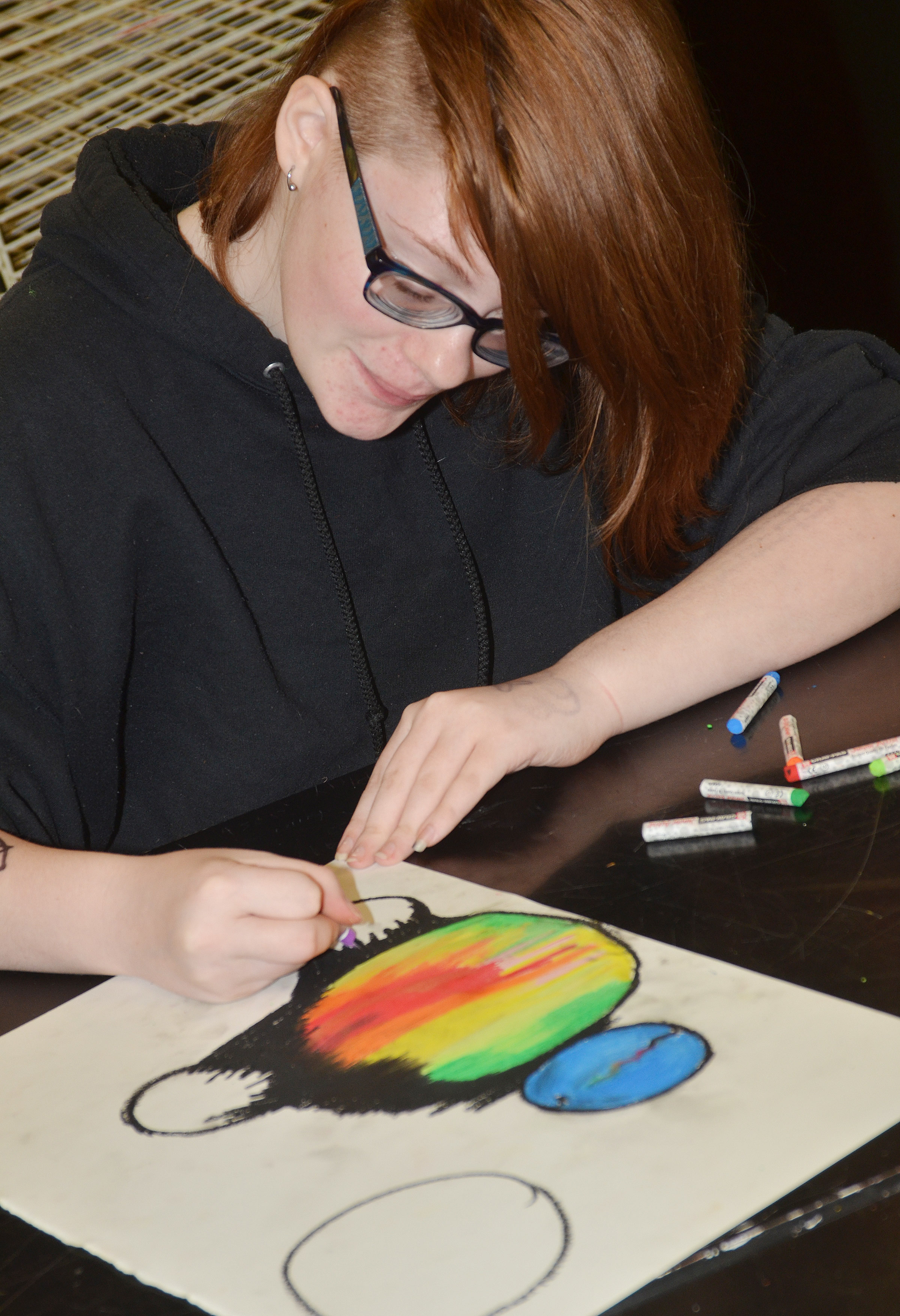 CHS freshman Sierra Releford adds color to her drawing.