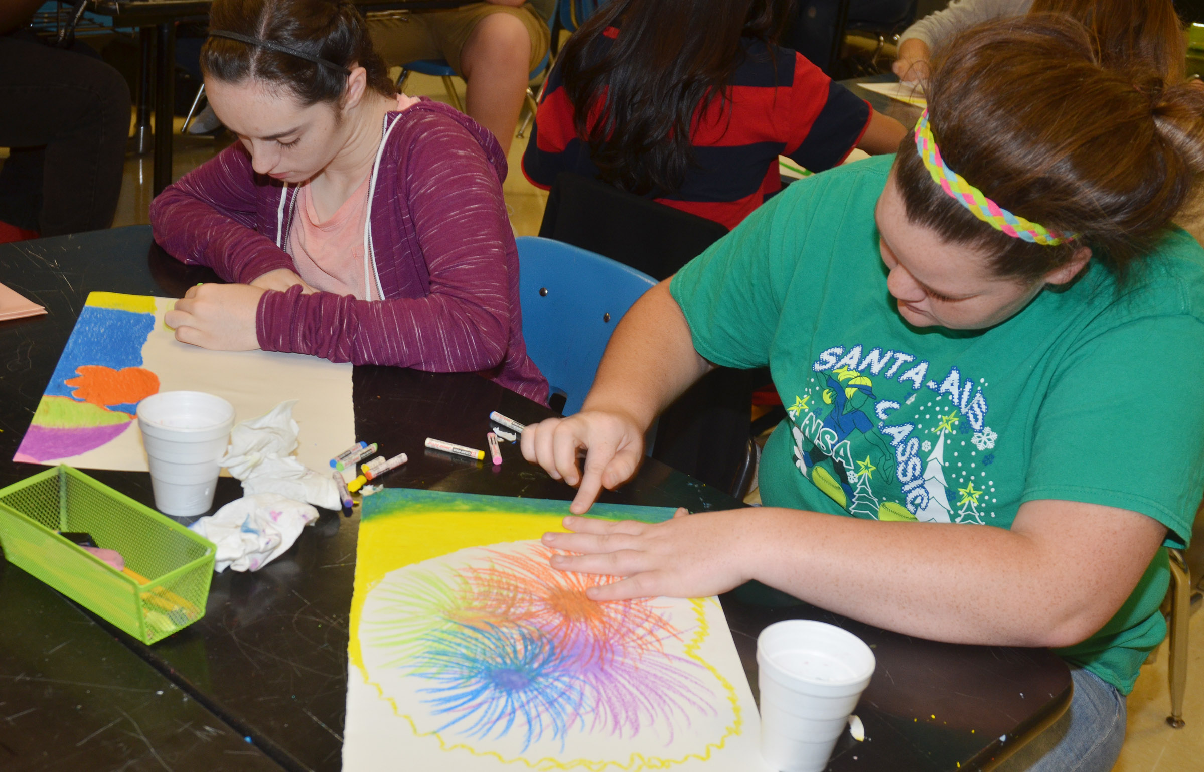 CHS sophomores Jewell Cox, at left, and Shallan Phlipott color their drawings with chalk pastels.