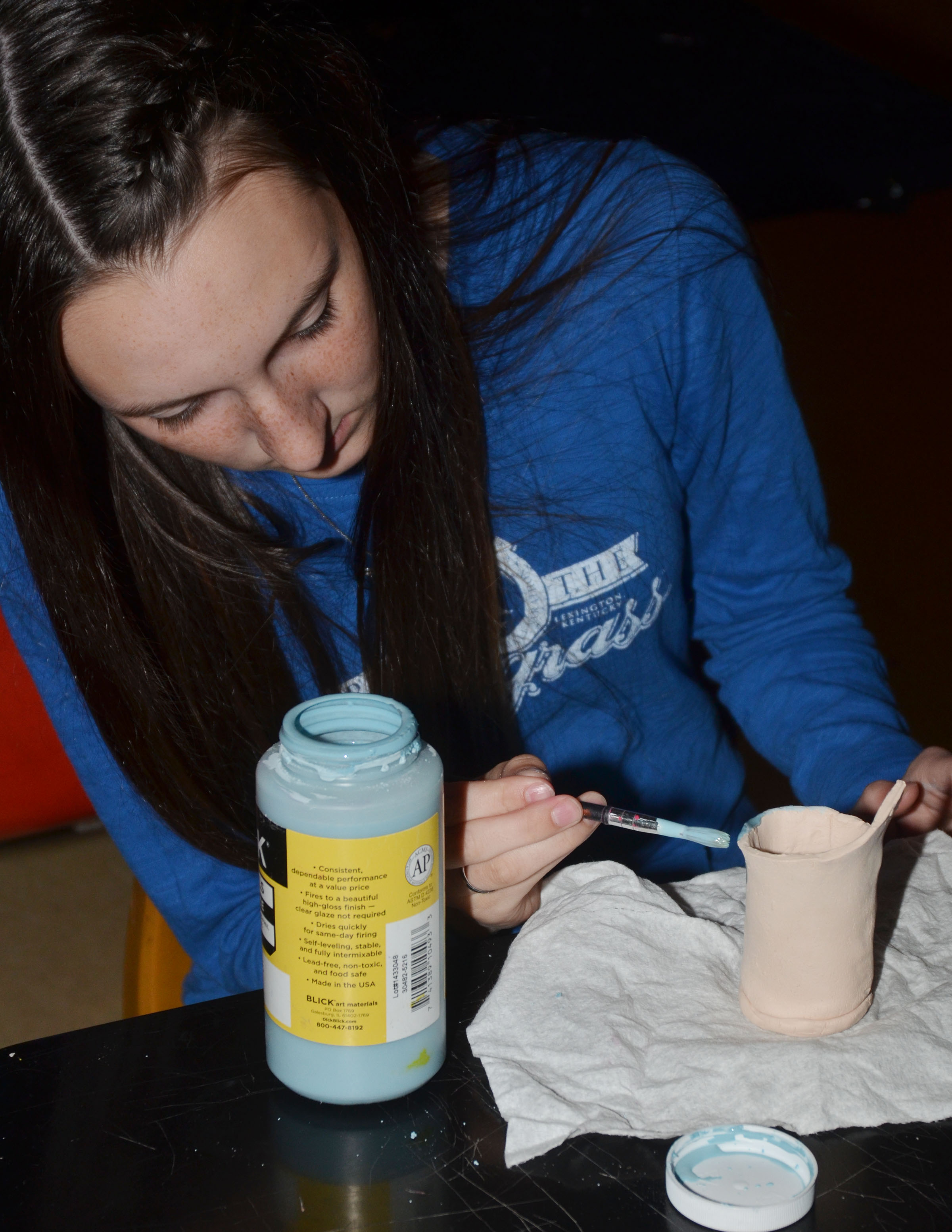 CHS freshman Zoe McAninch works on her final art project, a clay vase.