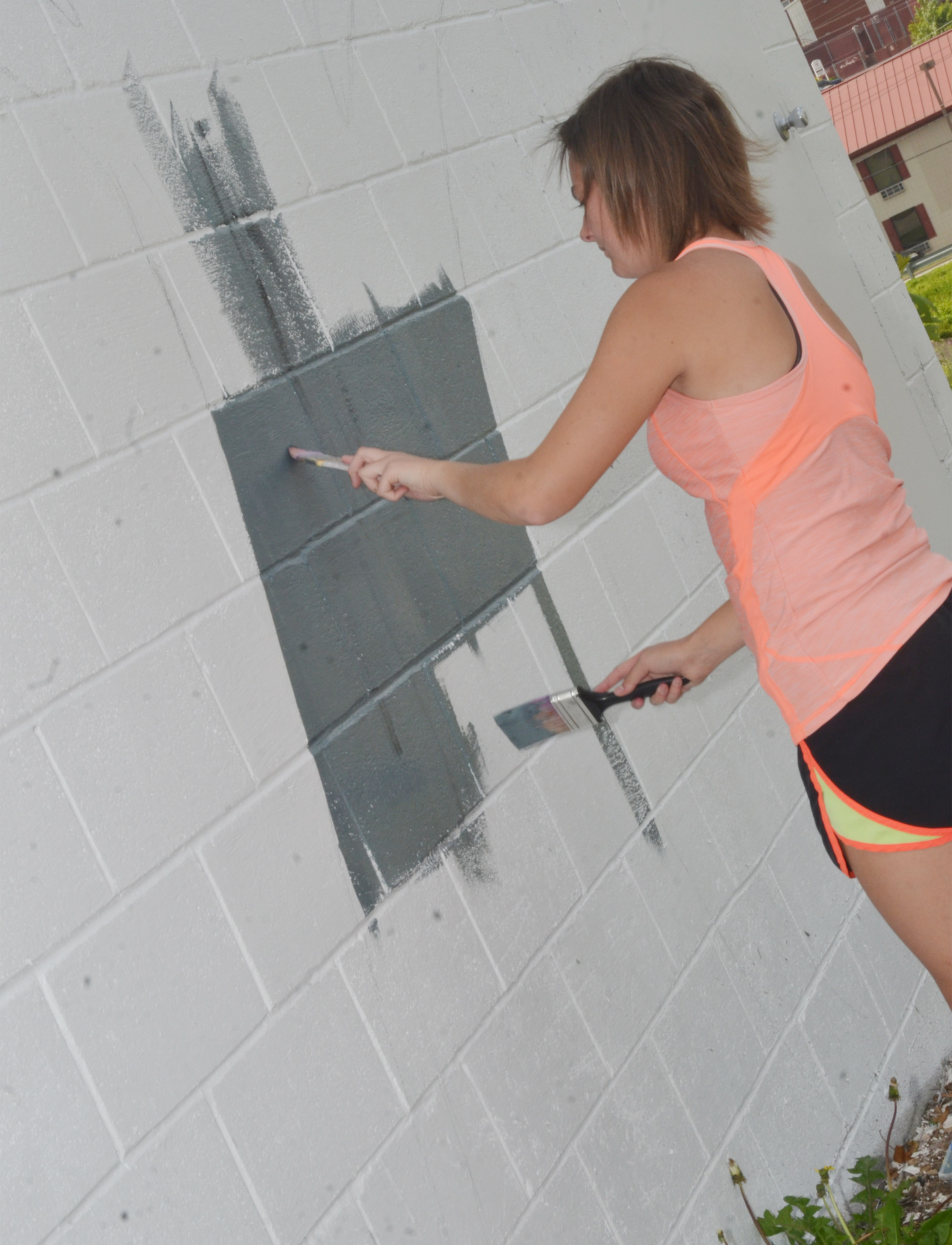 Kyrsten Hill, who graduated from CHS in May, paints the mural.