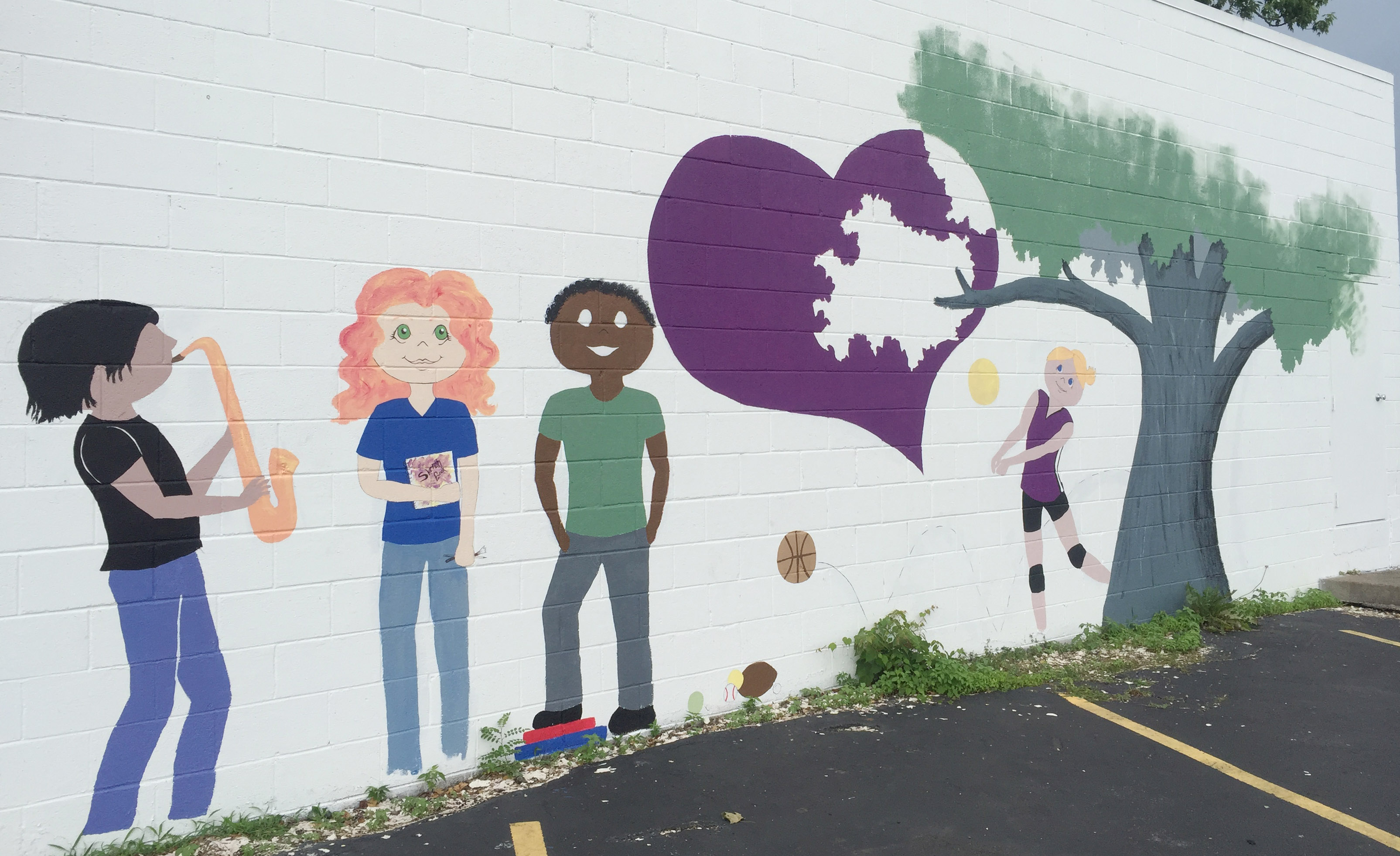 CHS art teacher Jo Ann Harris, along with art students Kyrsten Hill, who graduated from CHS in May, and Jasmine Cox, who will be a senior this fall, have designed, drawn and painted this mural. The mural is painted on the outside wall of Dr. Harold Wilkerson's dental office on West Main Street, across from the CHS campus.
