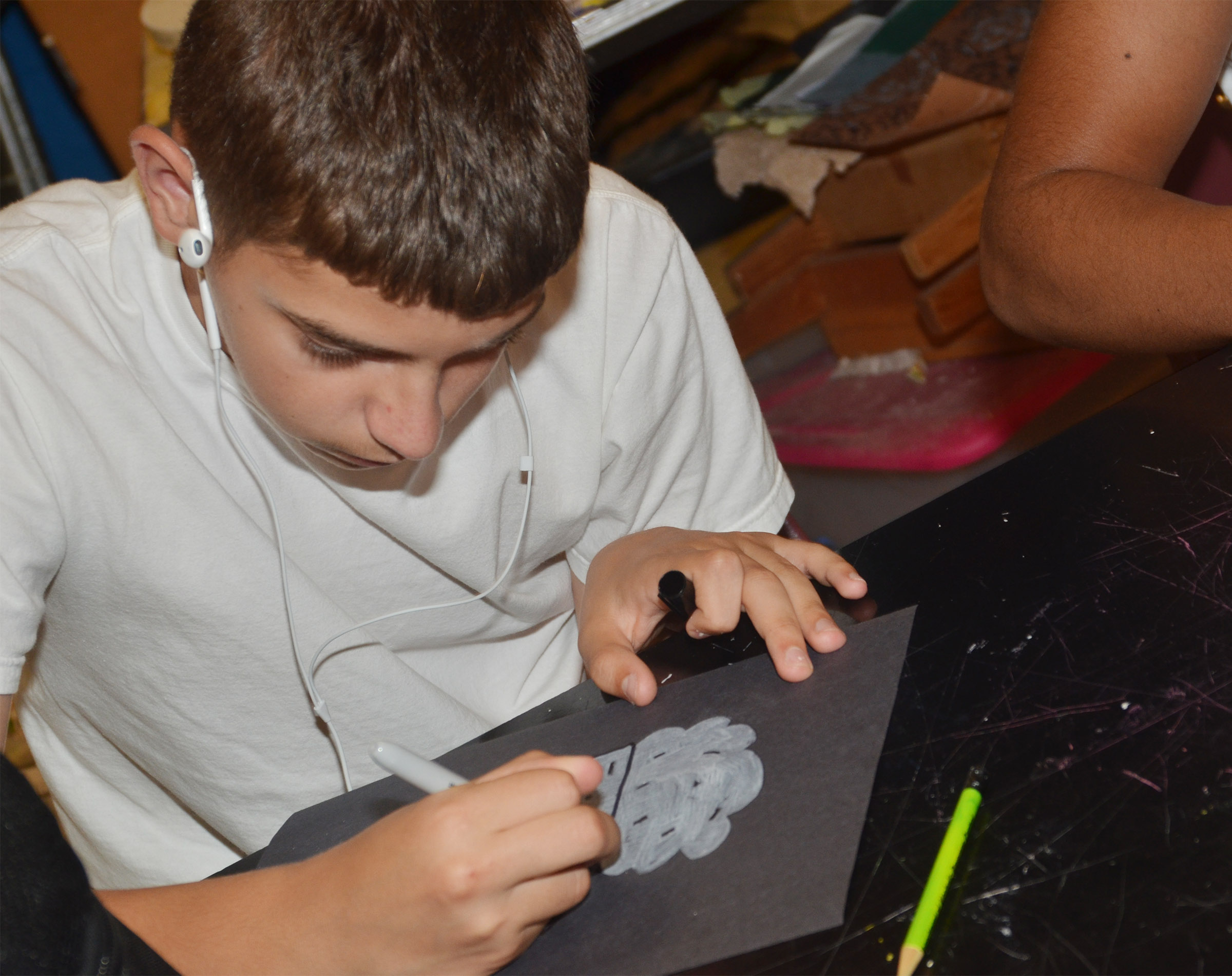 CHS sophomore Casey Hardin draws using neutral colors.