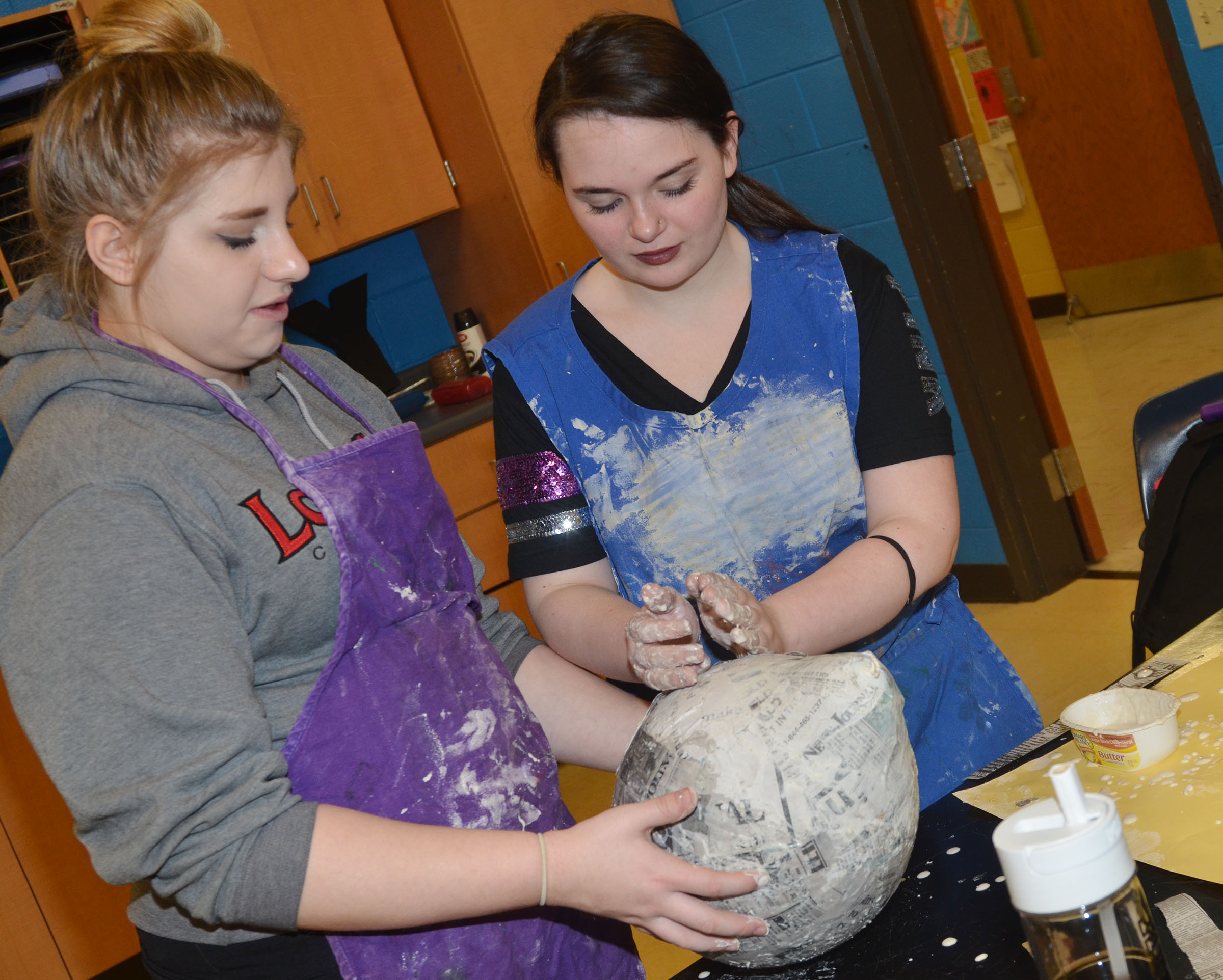 CHS freshman Jade Tungate, at left, and Summer Edwards smooth their 3D sculpture.