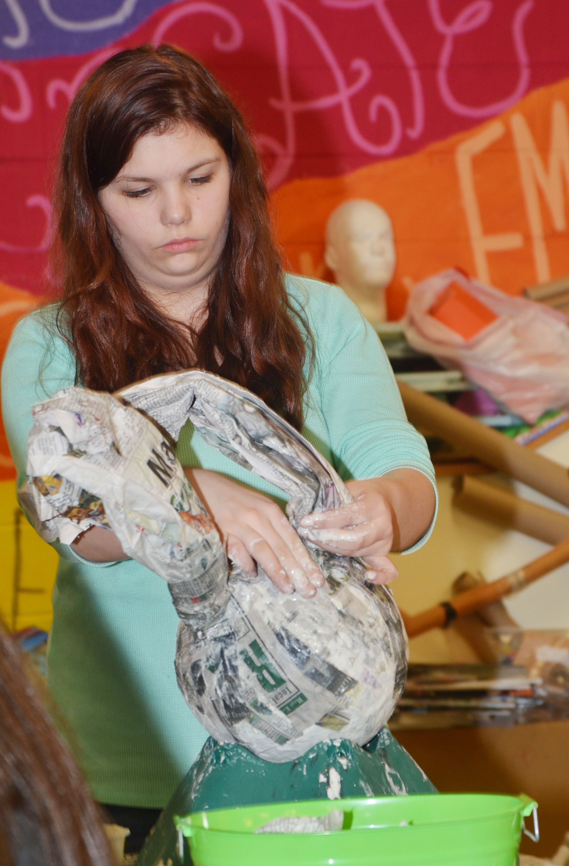 CHS freshman Shelby Hunt shapes the ears on her 3D paper mache project.