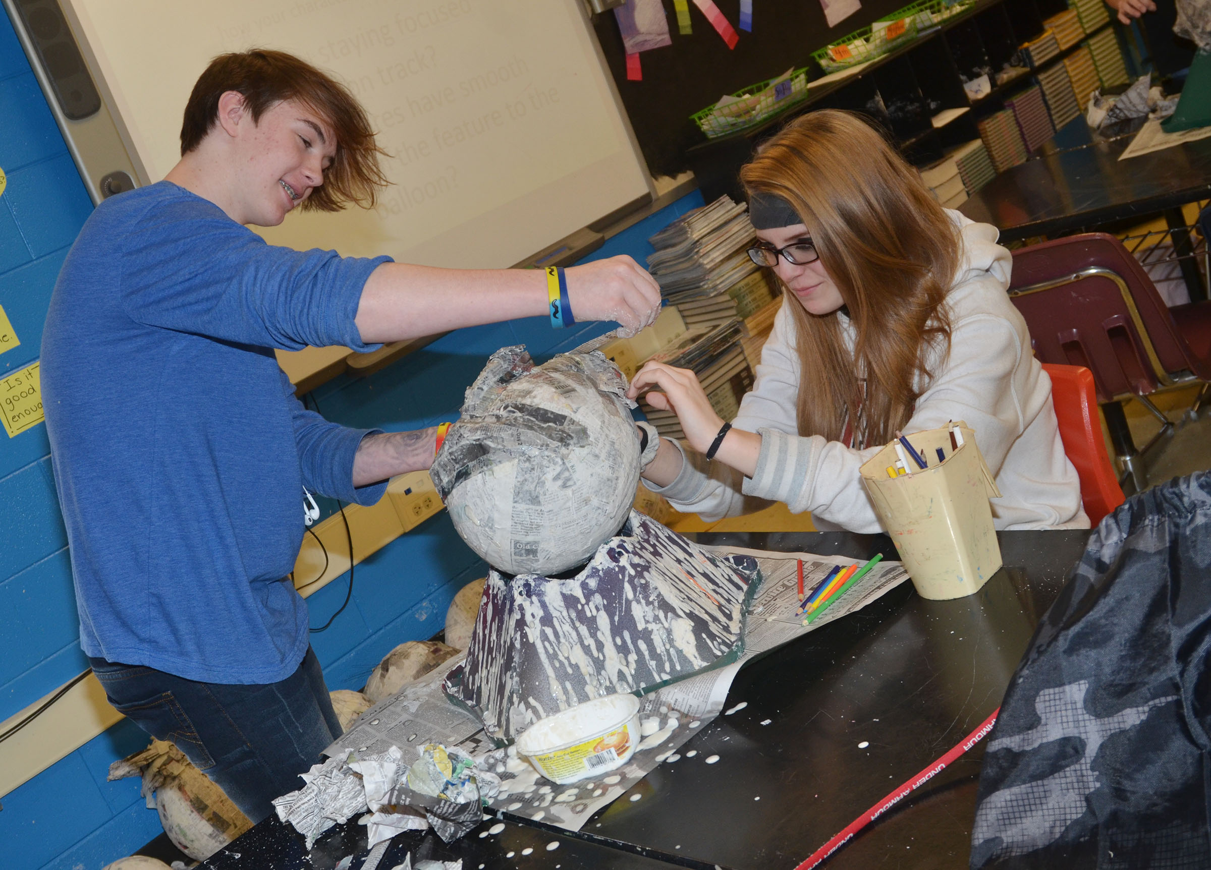 CHS sophomore Jason Agee, at left, and Jade Packard shape their 3D paper mache project.