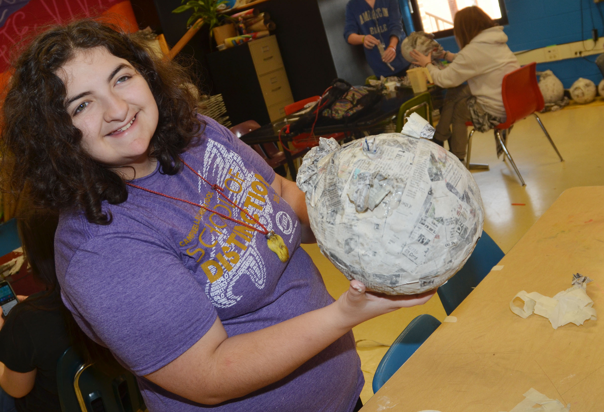 CHS sophomore Brooke Tucker holds her 3D paper mache project.