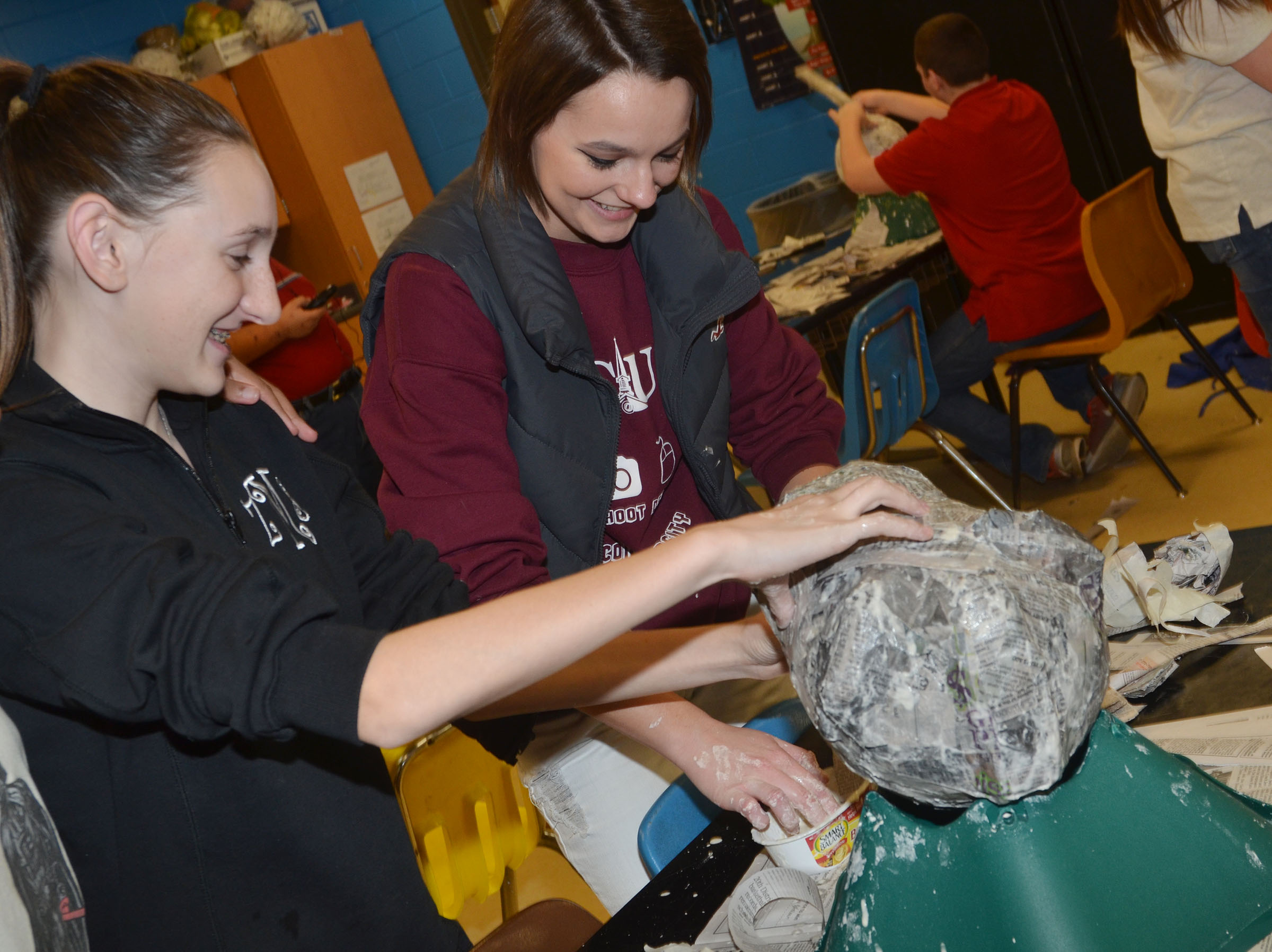 CHS freshman Zoe McAninch, at left, and senior Kyrsten Hill work on their 3D paper mache project.