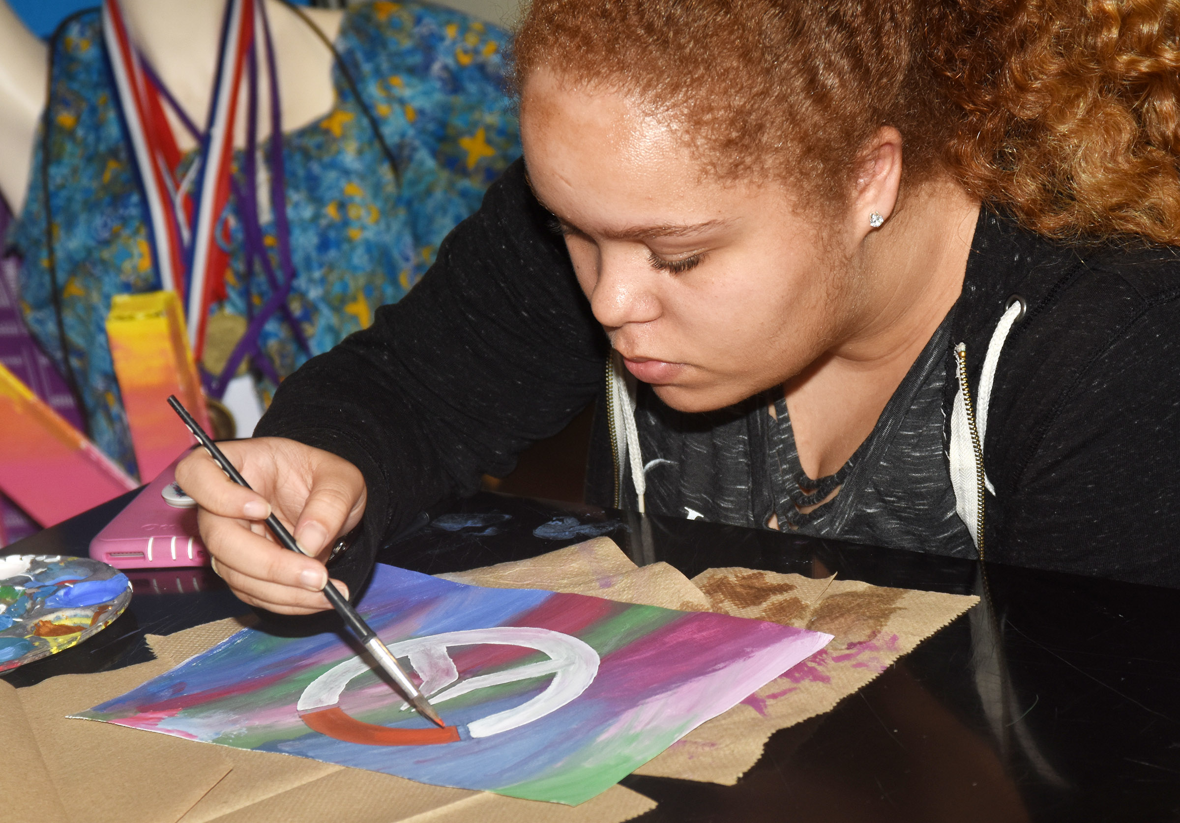 CHS senior Shailyn Fields paints her Pop Art.