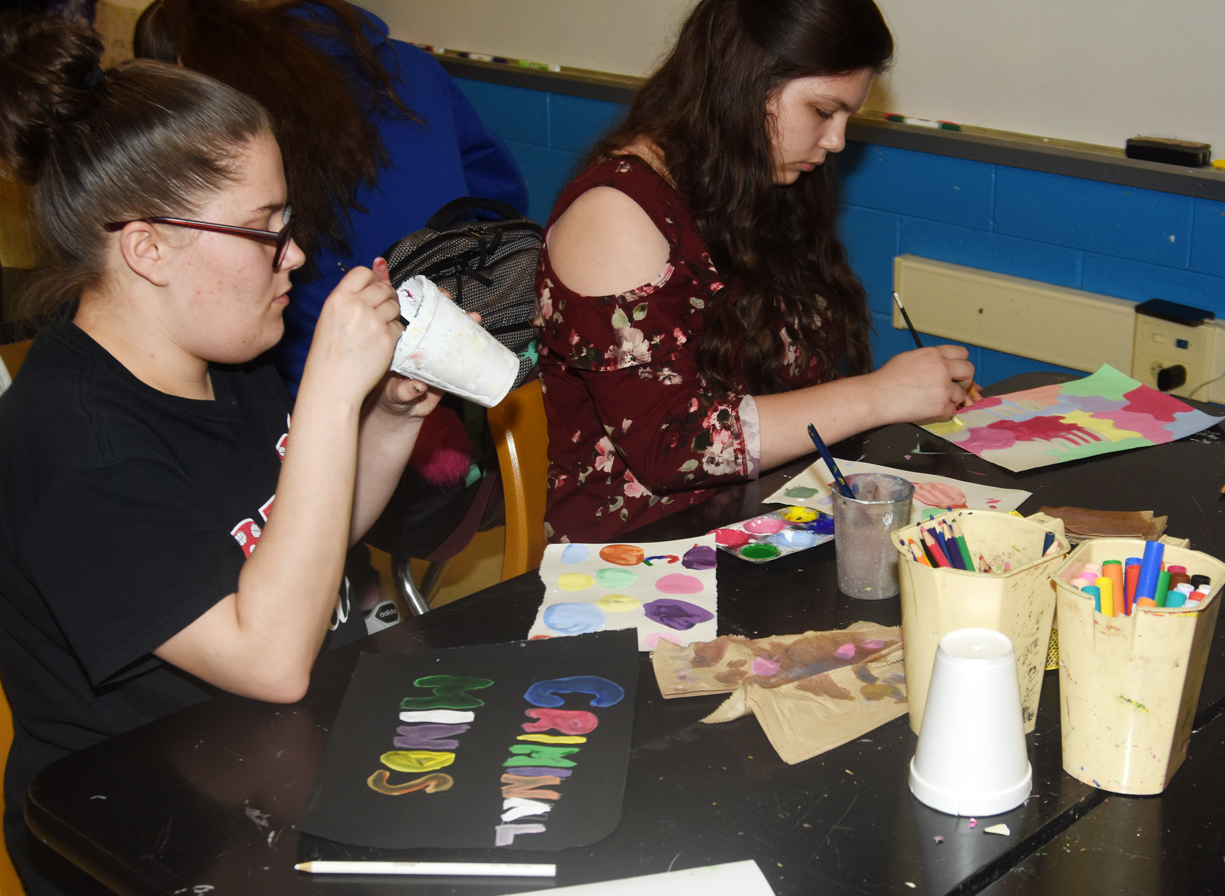 CHS sophomores Nevaeh Underwood, at left, and Shelby Hunt paint their Pop Art.