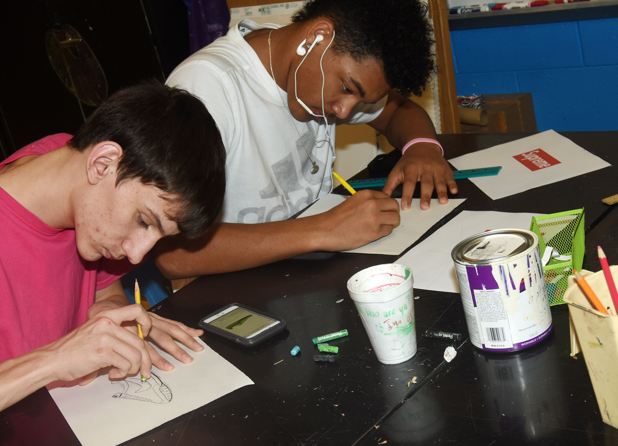 CHS junior Evan McAninch, at left, and freshman Reggie Thomas draw their Pop Art.