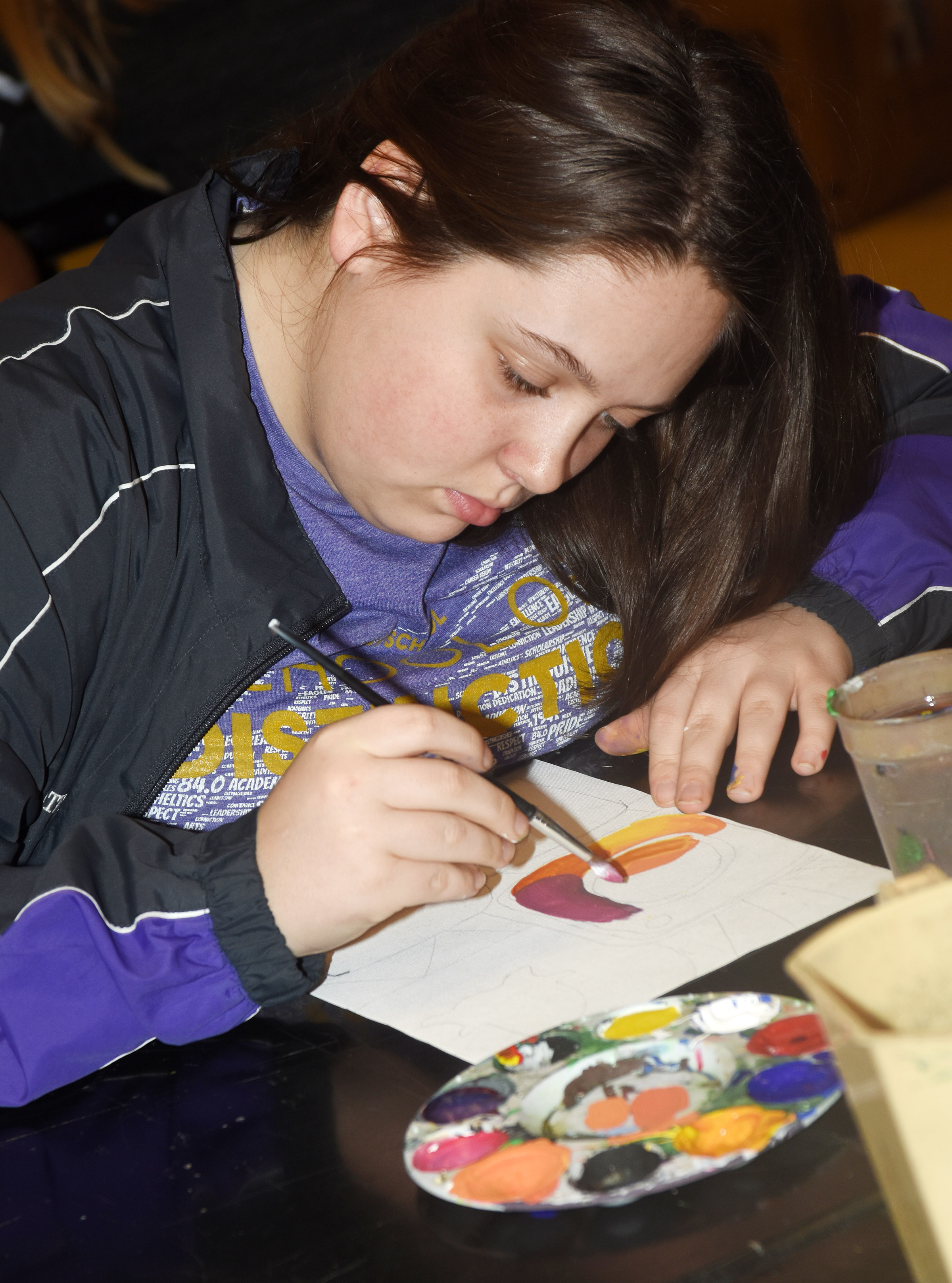 CHS junior Ruby Hatfield paints her Pop Art.