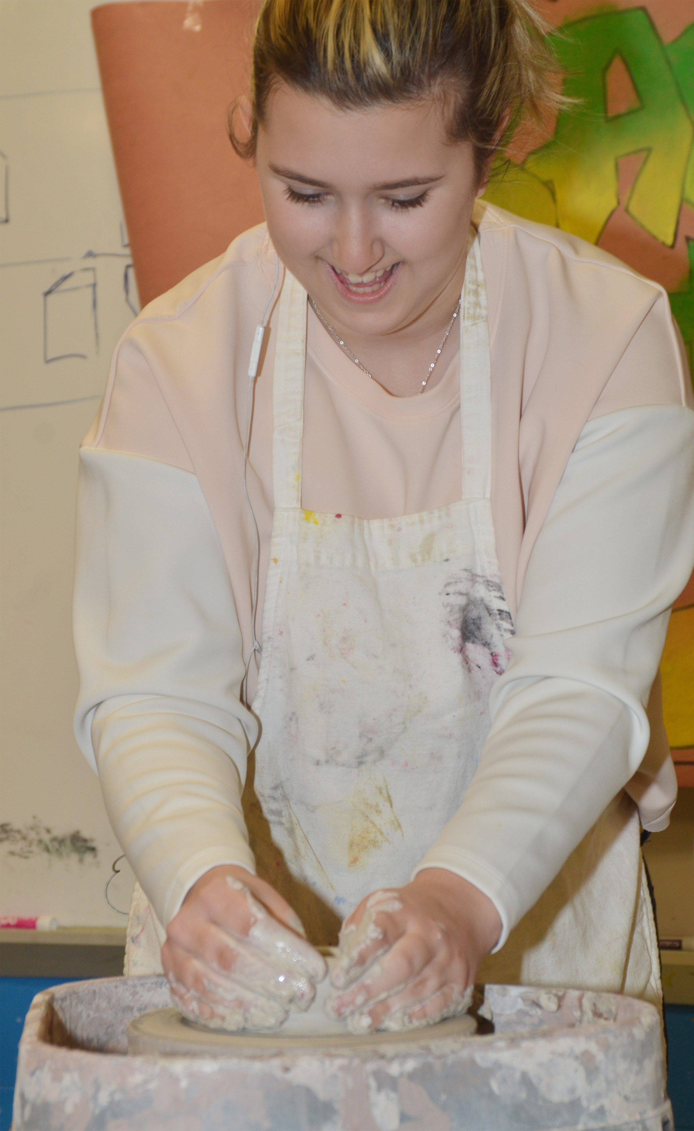 CHS junior Jenny Lantz tries the potter's wheel.