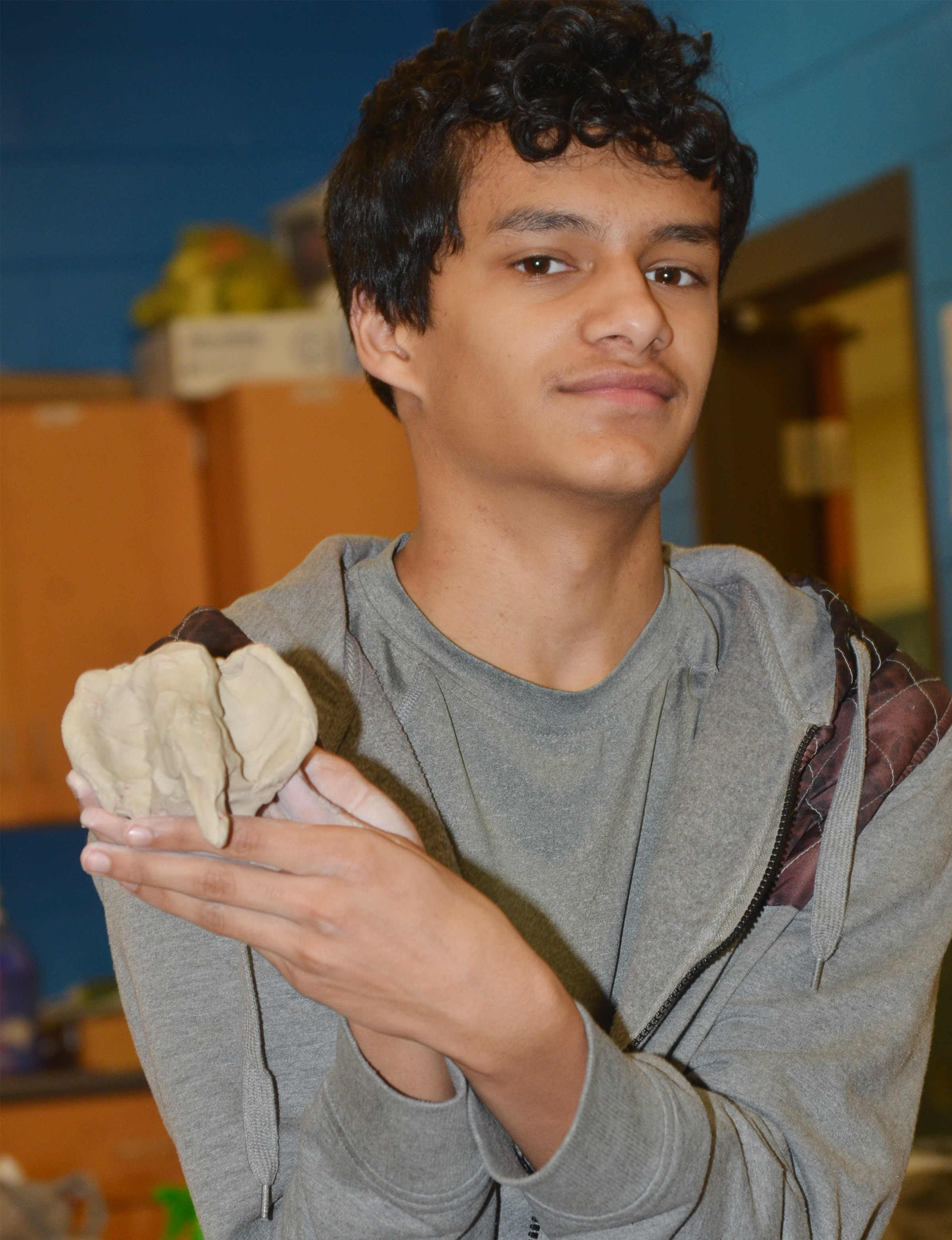 CHS freshman Ben Arachi holds an elephant he made out of clay.
