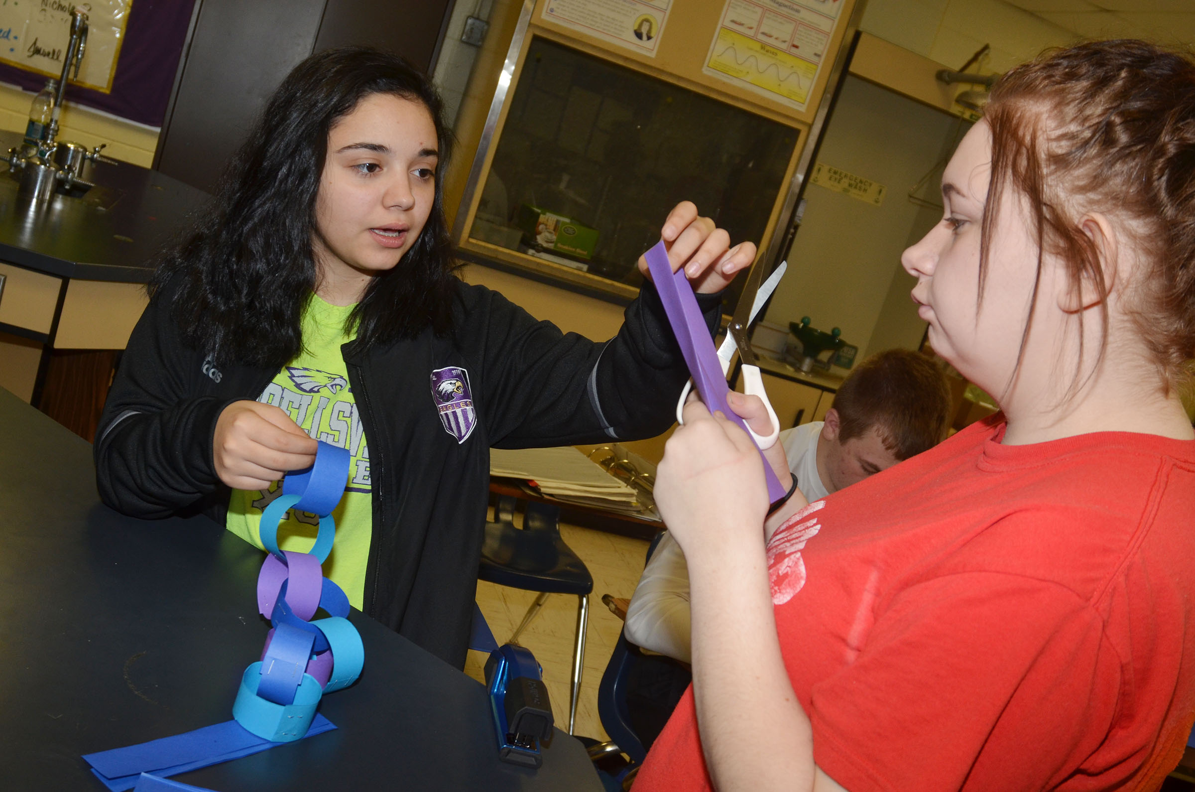 CHS freshman Fatimah Alabusalim, at left, and Leslie McKenzie make Christmas ornaments.