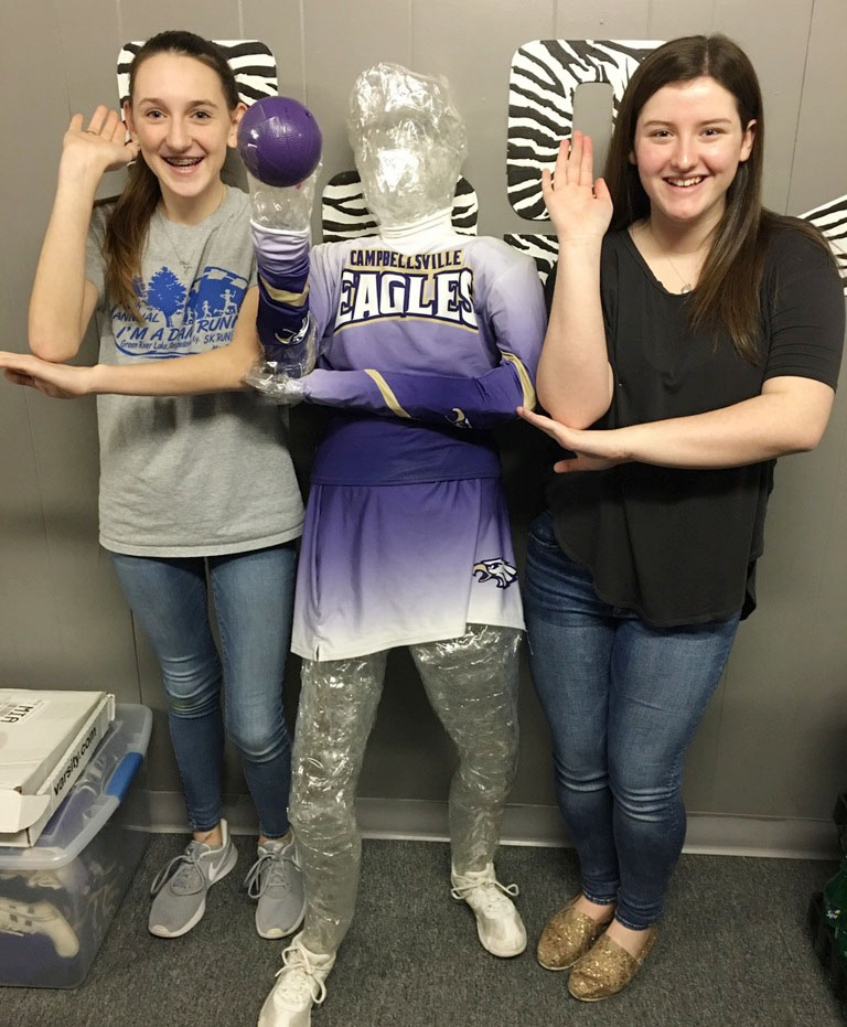 CHS freshman Zoe McAninch, at left, and Alli Wilson pose with their tape sculpture.