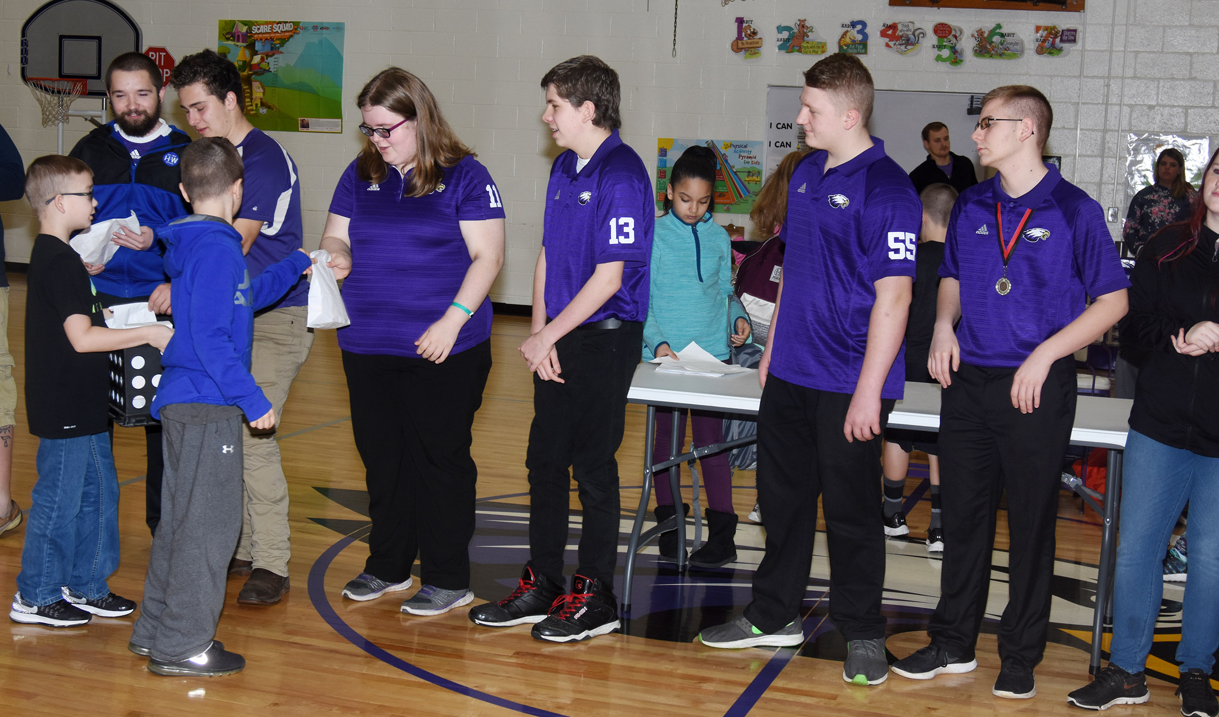 CHS bowling members receive treat bags at the CES assembly on Friday, Feb. 16.