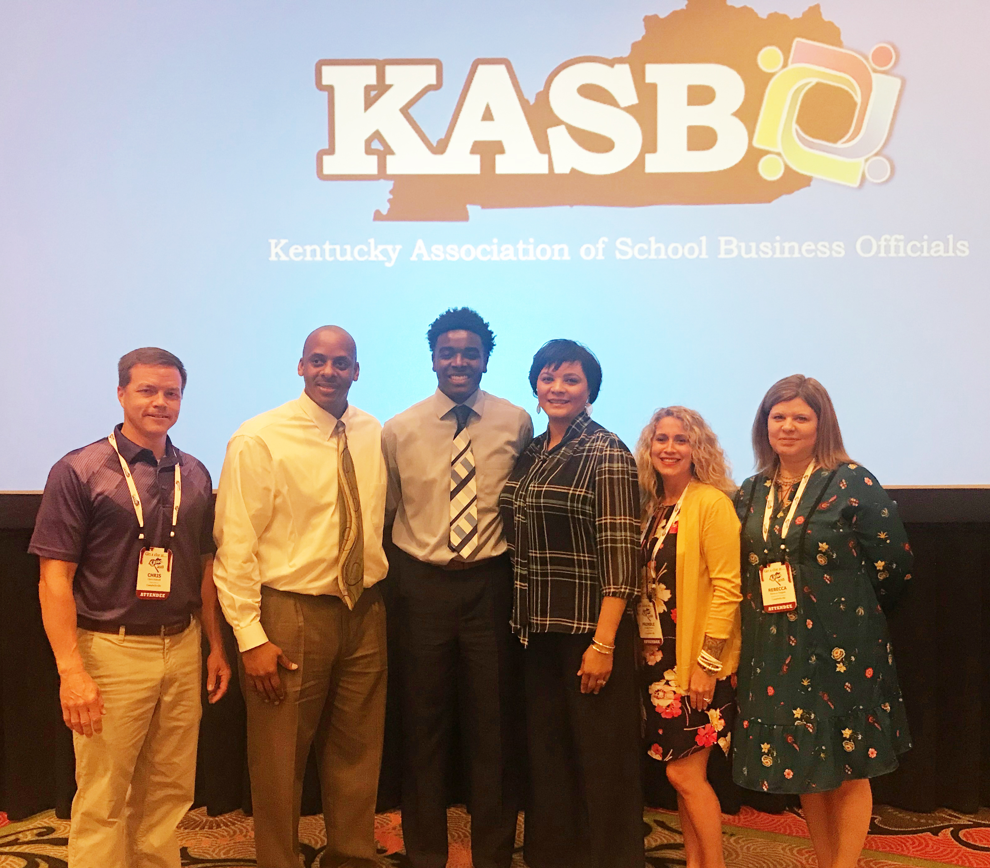 CHS senior Chanson Atkinson has received a scholarship from the Kentucky Association of School Business Officials. He was presented the scholarship at the KASBO spring conference at the Galt House in Louisville. From left are Campbellsville Independent Schools Associate Superintendent and Finance Director Chris Kidwell, Atkinson and his parents Al and Rochelle Brady, CIS Accounts Payable Prindle Hinton and CIS Payroll Clerk/Insurance Coordinator Rebecca Tungate.
