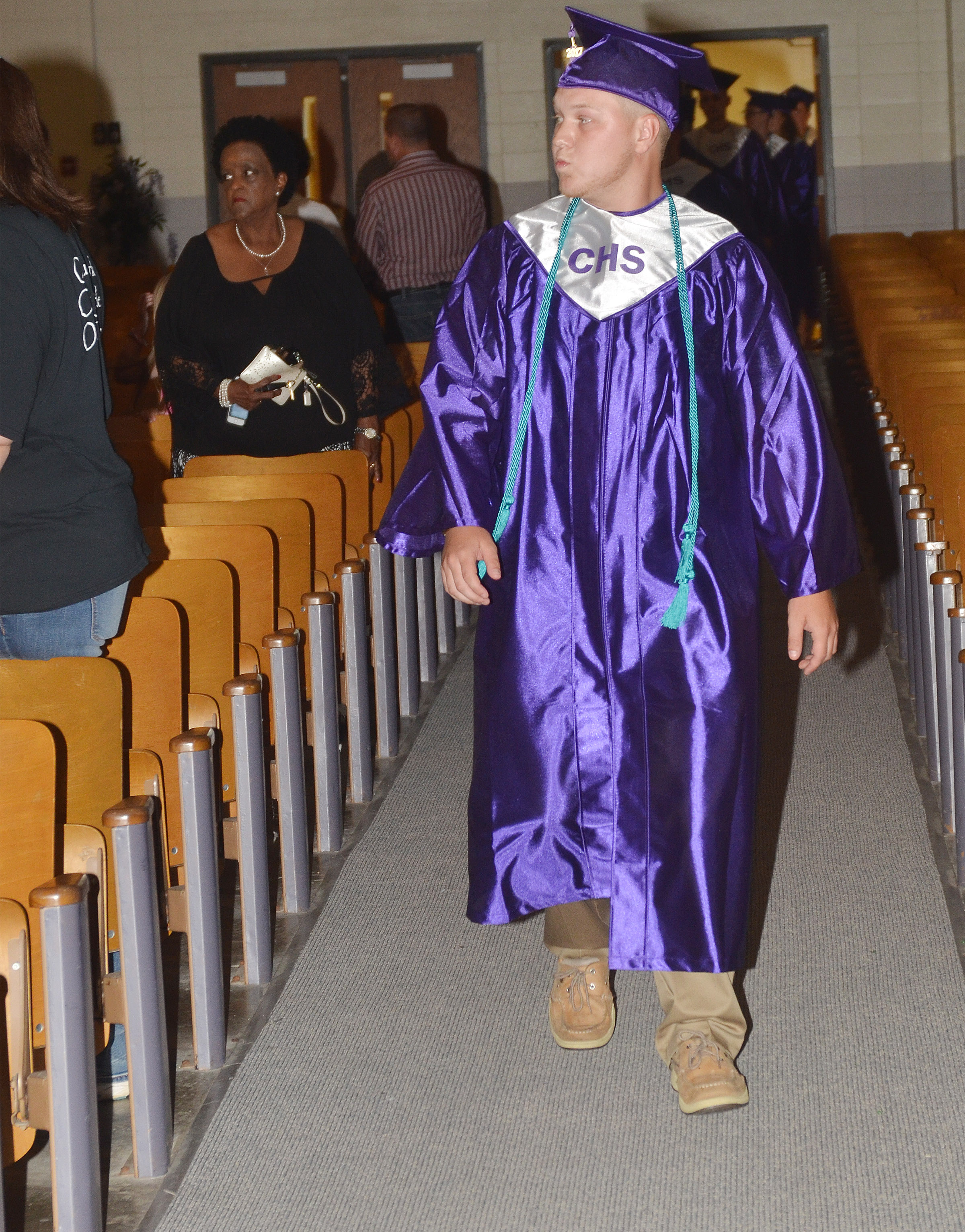 CHS senior Noah Wagers walks in Hamilton Auditorium for the baccalaureate ceremony.