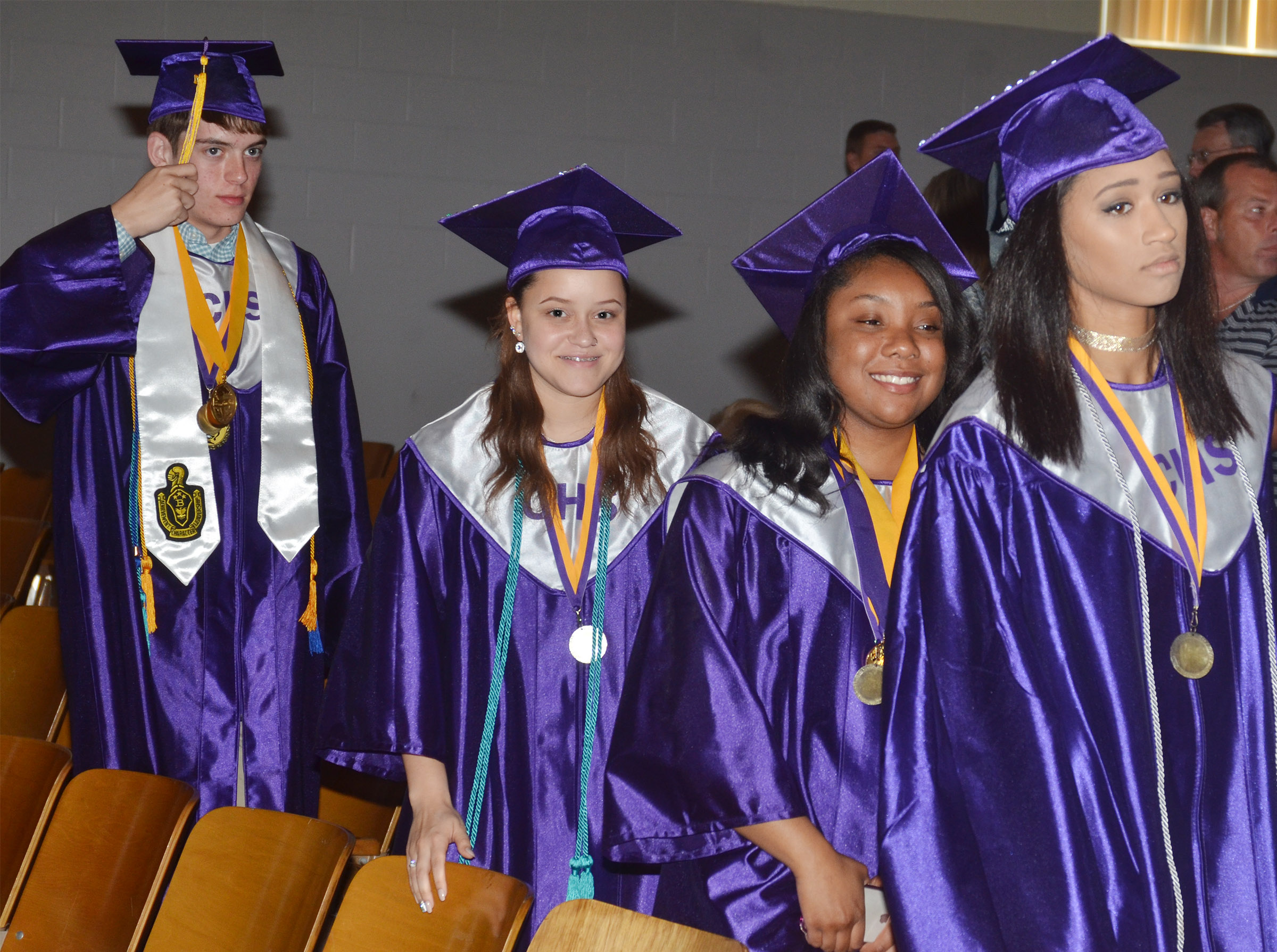 From left, CHS seniors Murphy Lamb, Breanna Spaulding, Kayla Atkinson and Alexis Shears walk out of Hamilton Auditorium after the baccalaureate ceremony.