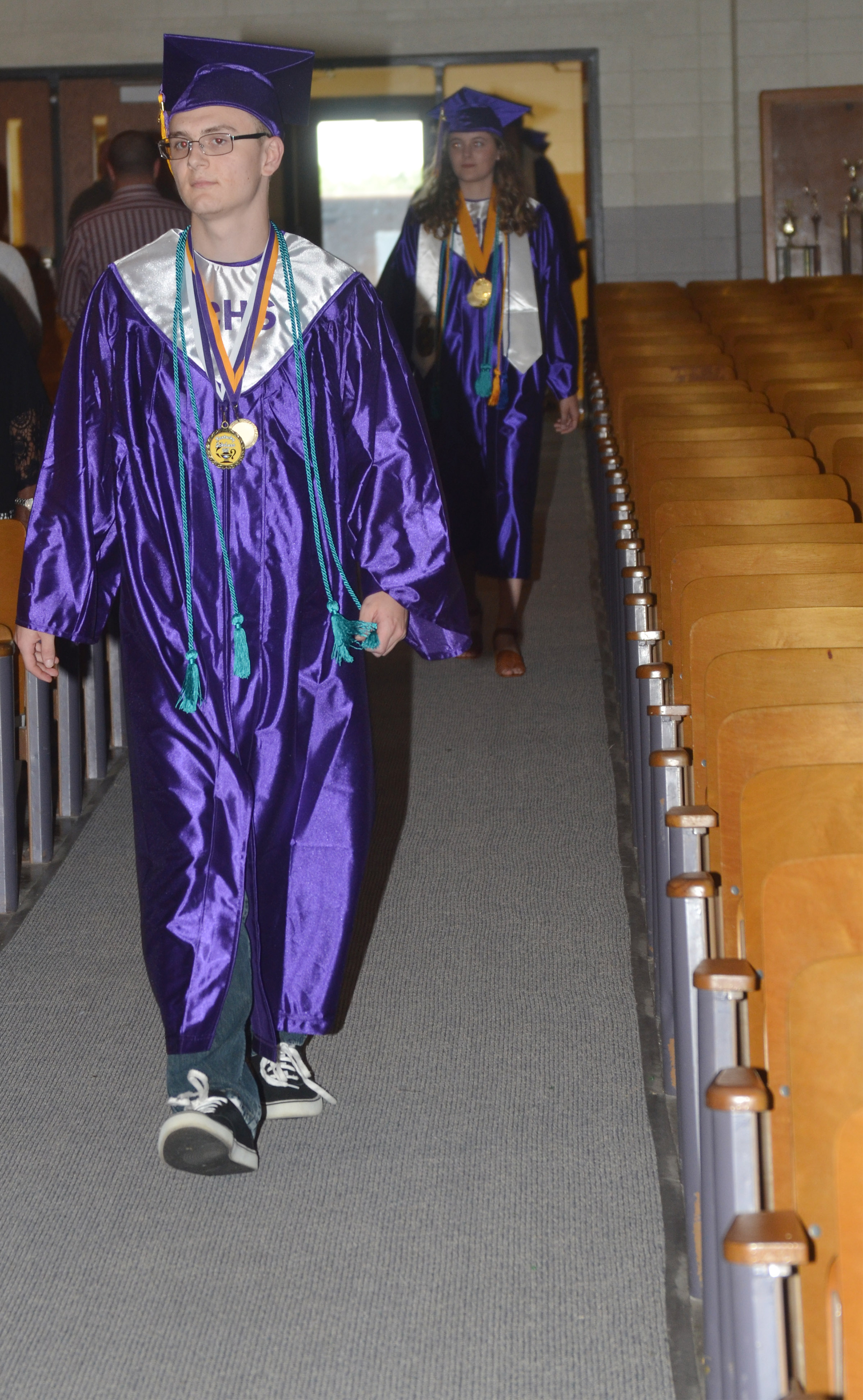 CHS senior Ben Rafferty walks in Hamilton Auditorium for the baccalaureate ceremony.