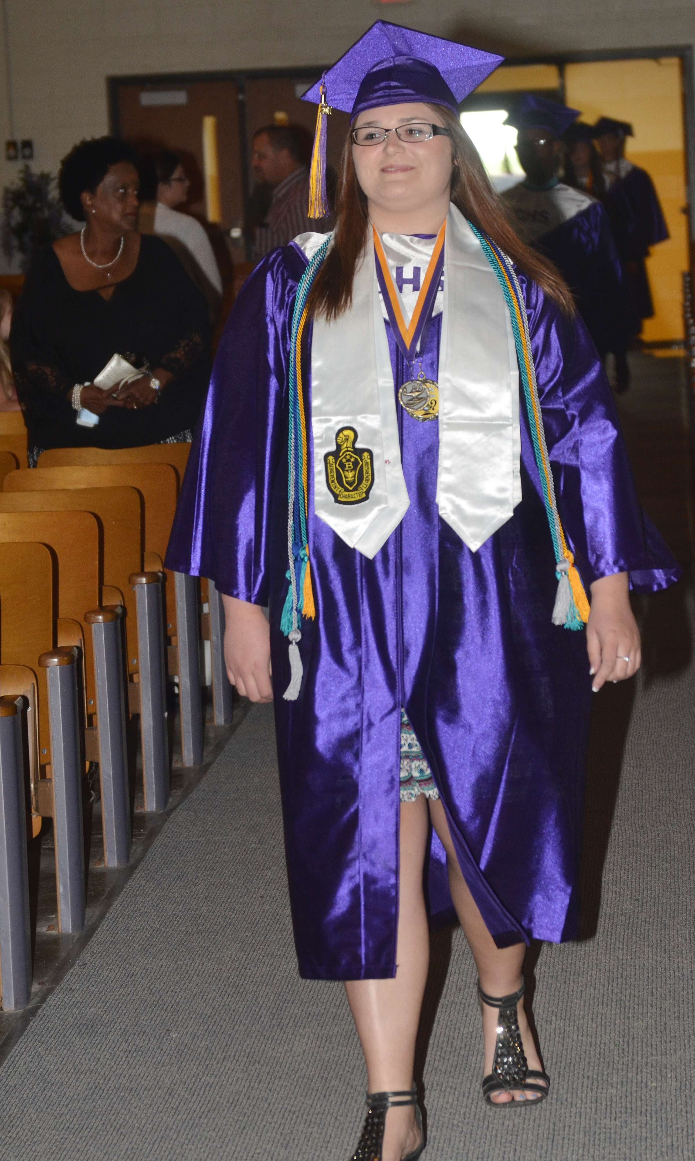 CHS senior Vera Brown walks in Hamilton Auditorium for the baccalaureate ceremony.