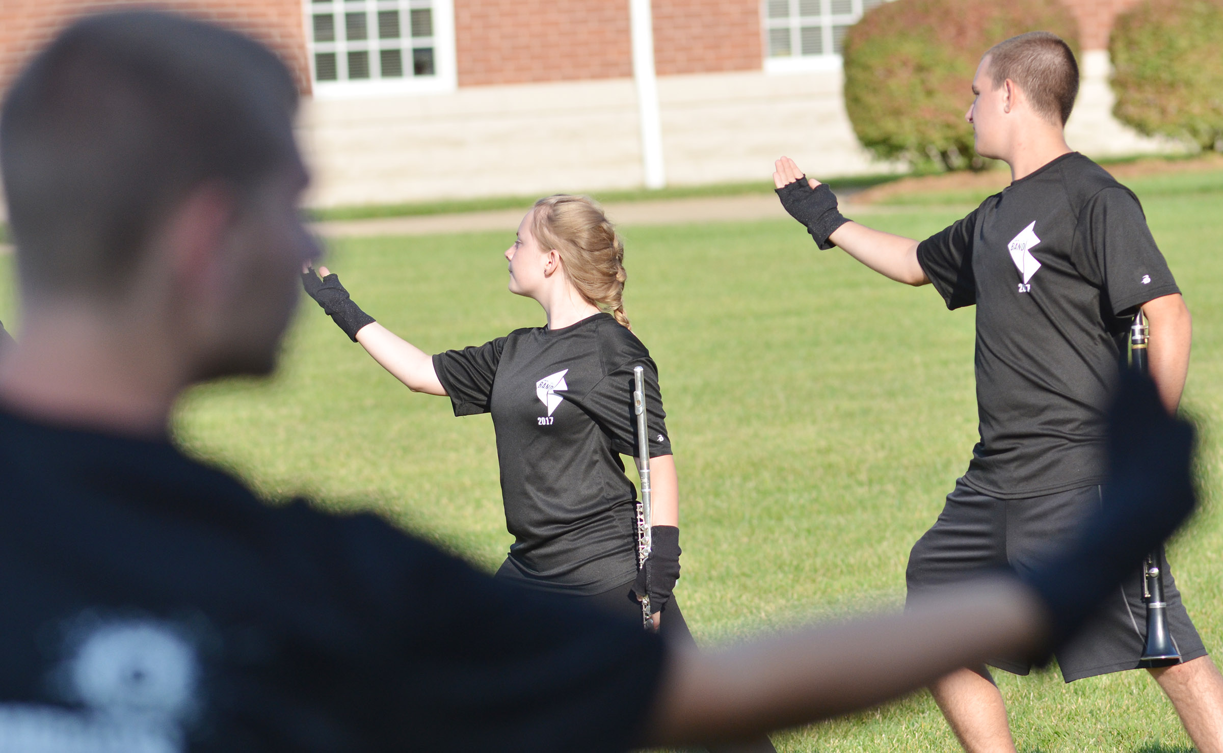 CHS freshman Emily Hayden, at left, and senior Austin Fitzgerald perform during warmup.