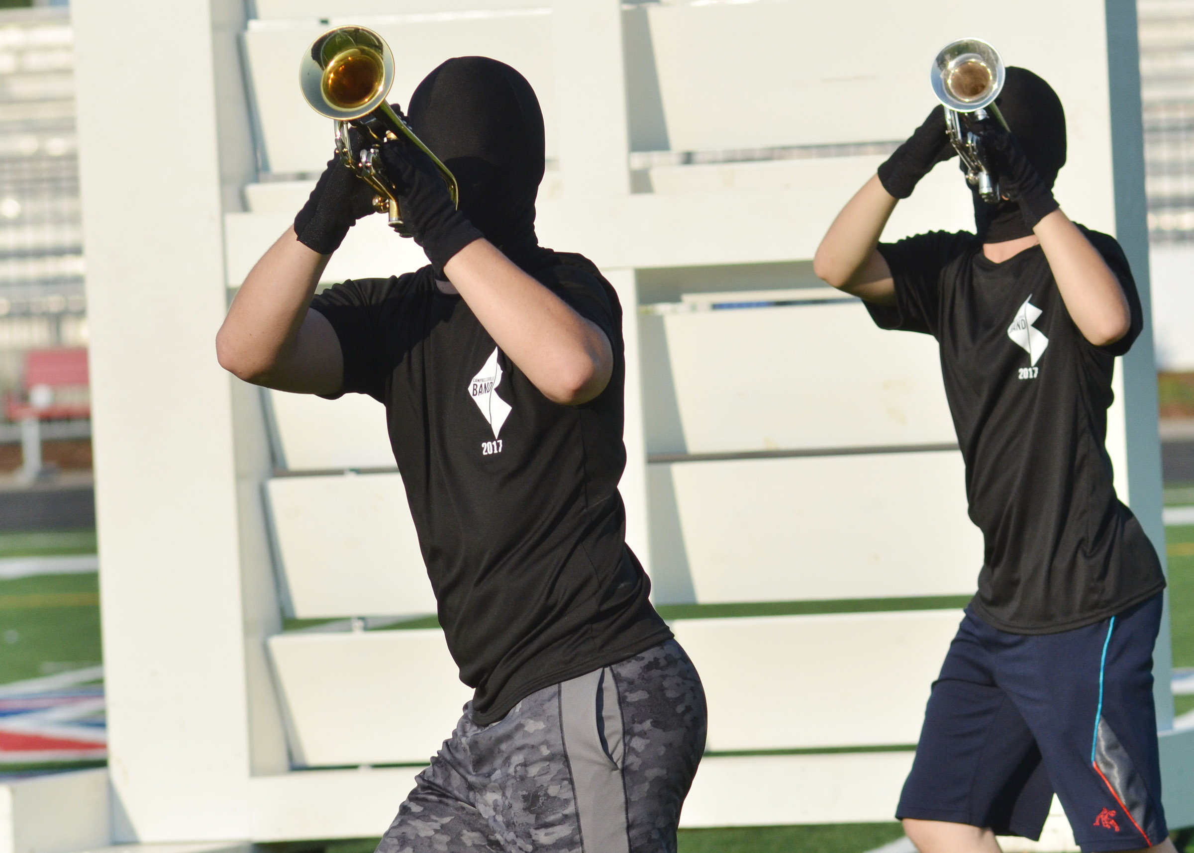CHS junior Josh Dooley, at left, and sophomore Tristin Lopez play trumpet.