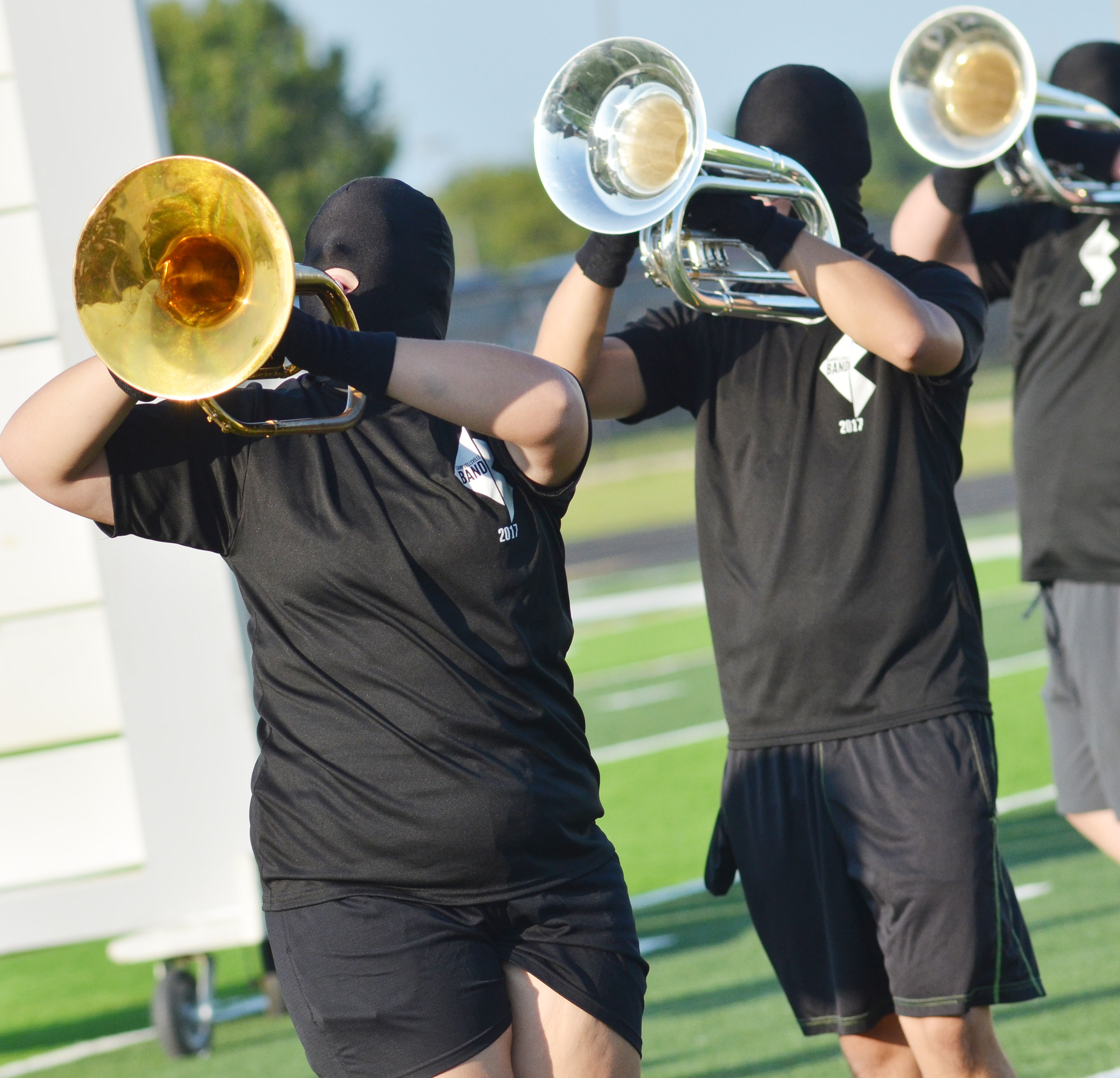 CHS sophomore Abie Angel, at left, plays horn. At right is senior Chaz Babbs.