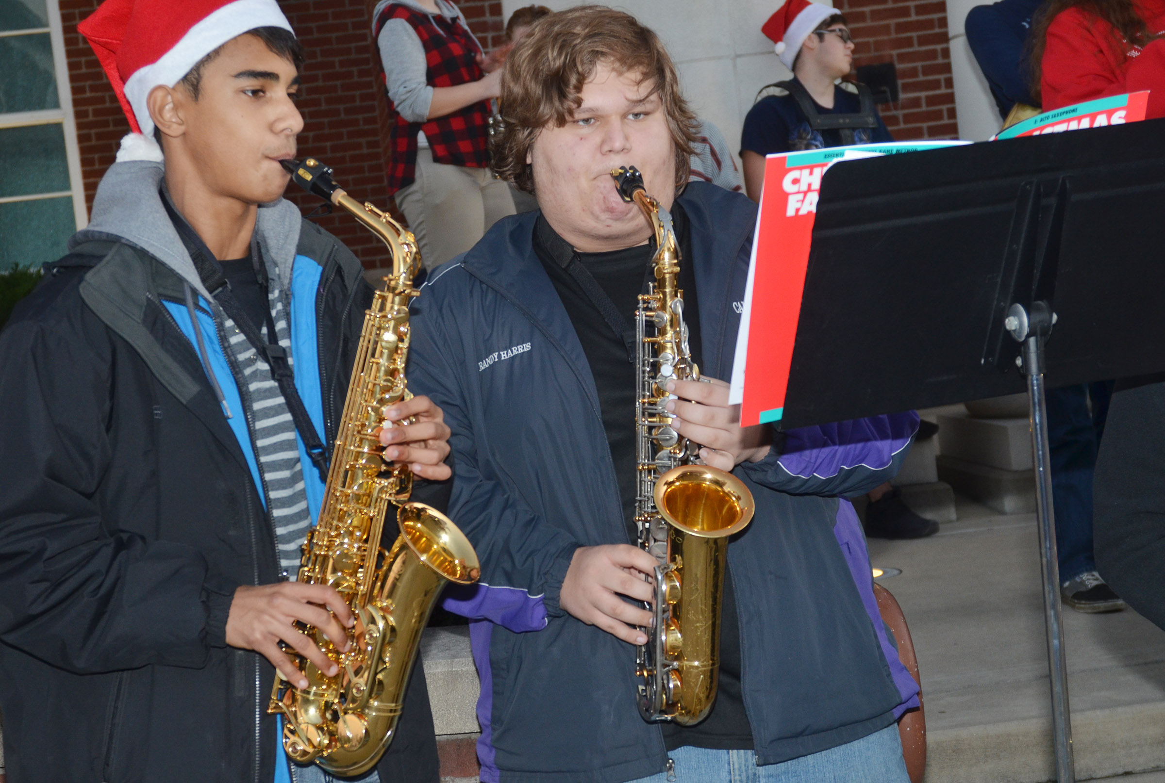 CHS sophomore David Silva, at left, and junior Randy Harris play saxophone.