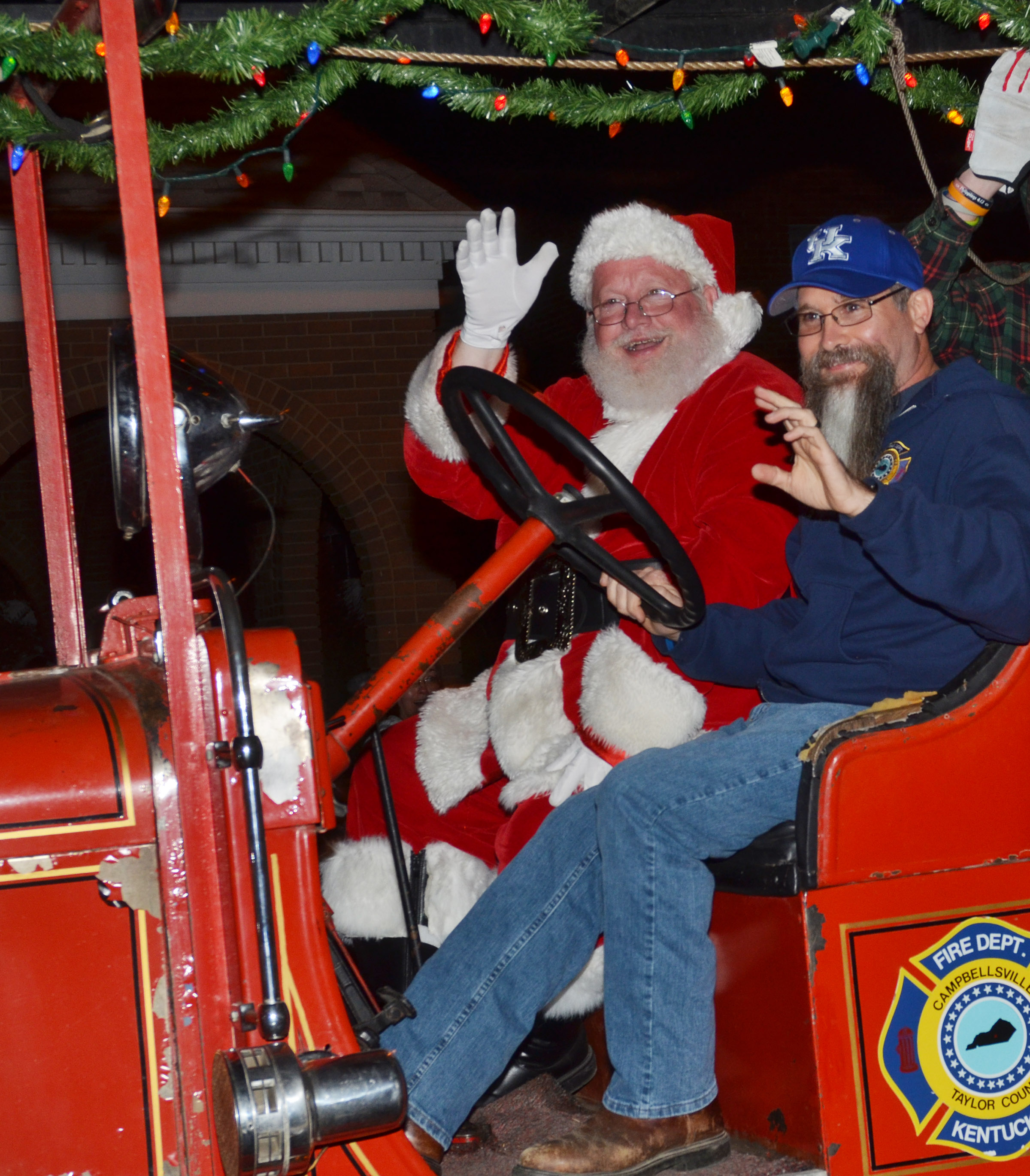 Campbellsville elementary, middle and high school custodial worker Randy Bricken drives Santa in the City of Campbellsville's annual Christmas parade.