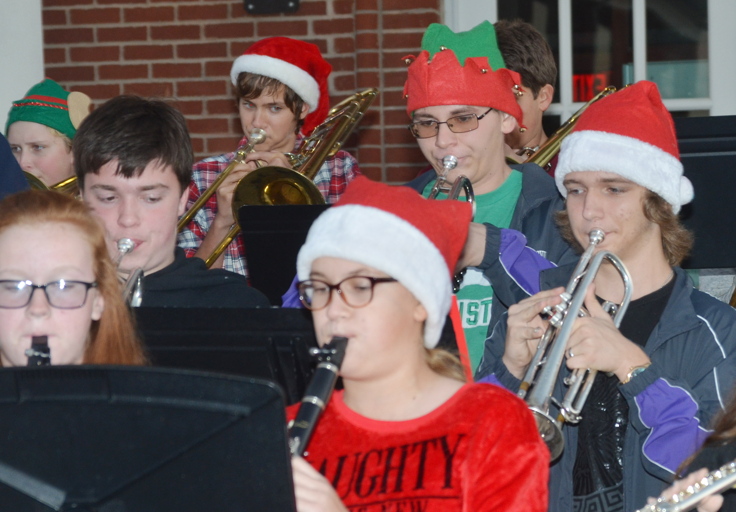 Second row, from left, CHS sophomore Grant Rinehart, junior Brandon Greer and sophomore Tristin Lopez play trumpet.