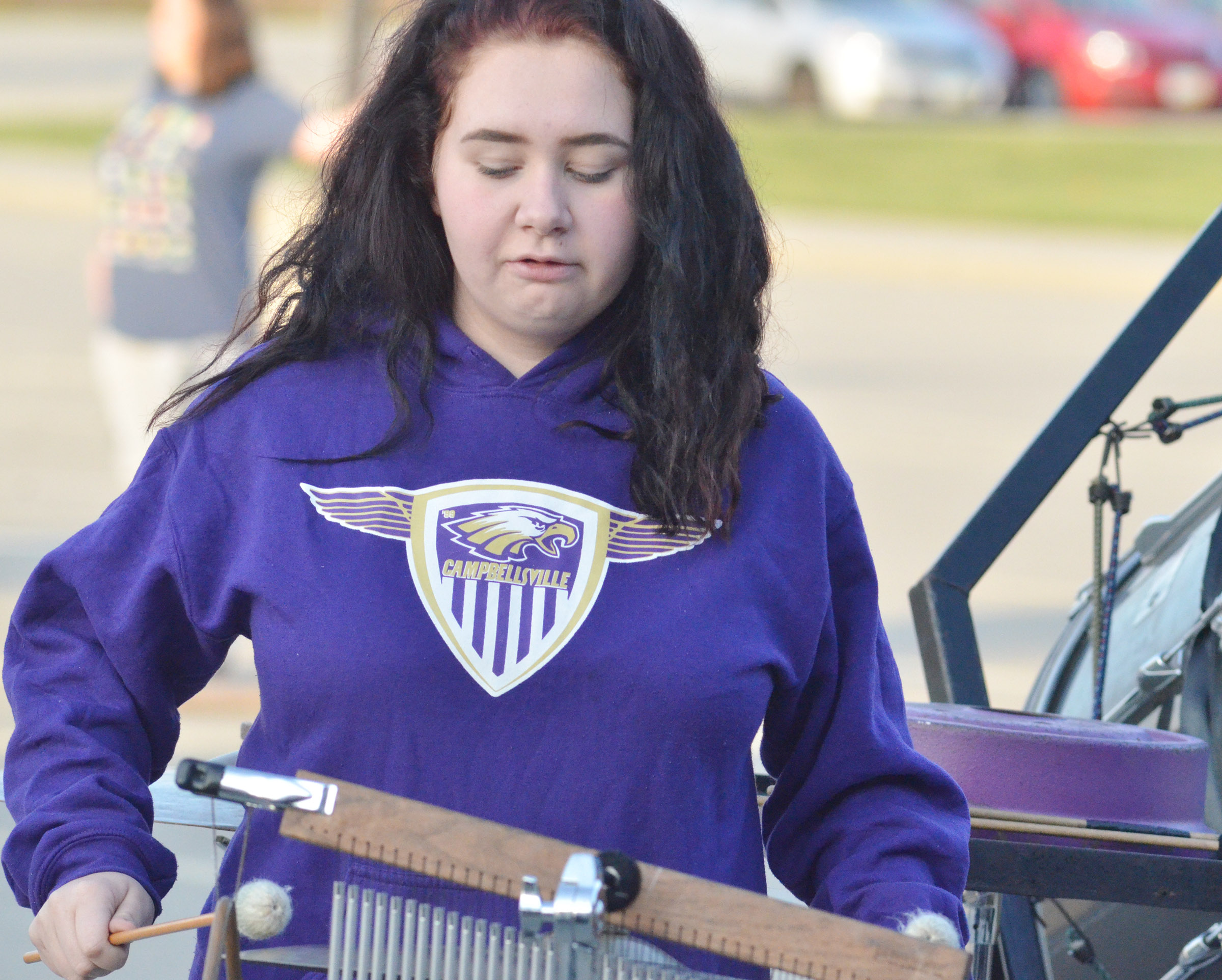 CHS junior Leslie McKenzie plays percussion during the last practice of the season.