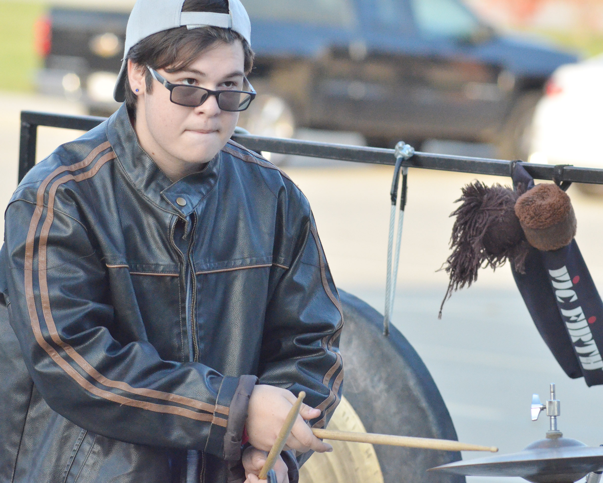 CHS junior Kyler Rakes plays percussion during the last practice of the season.