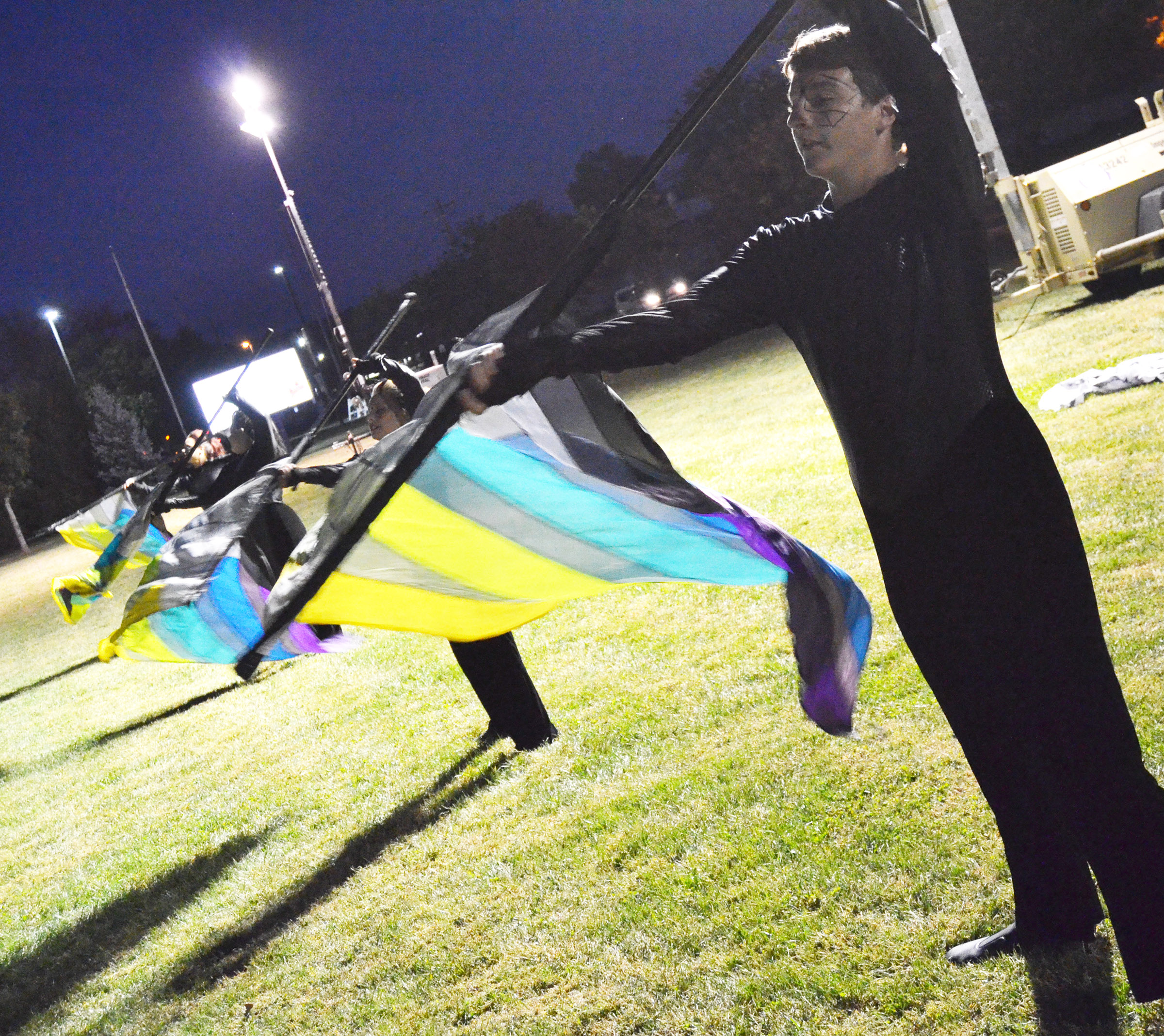 CHS freshman Nick Drew performs with his fellow color guard members in warmup.